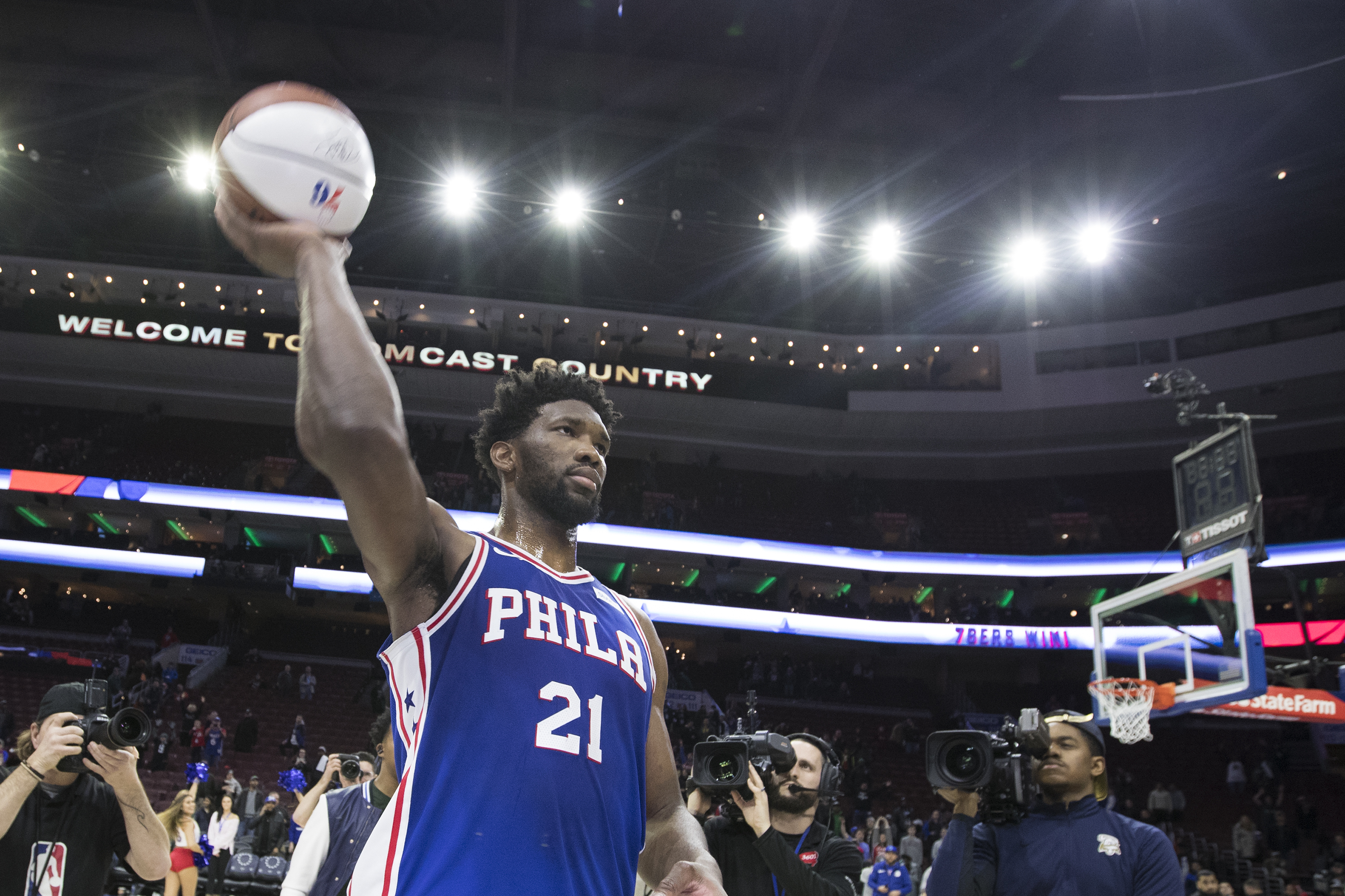 After being named player of the game, Joel Embiid of the Sixers throws an autographed basketball into the crowd. The Sixers defeated the Wizards 115-102 at the Wells Fargo Center on Feb. 6, 2018.