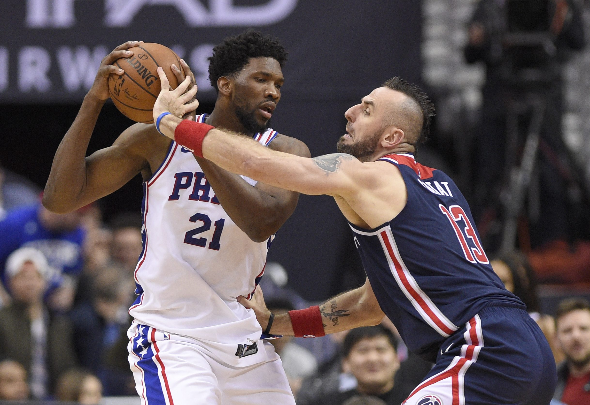 Wizards center Marcin Gortat fights for the ball against Joel Embiid during the Sixers 109-94 loss Sunday in Washington.