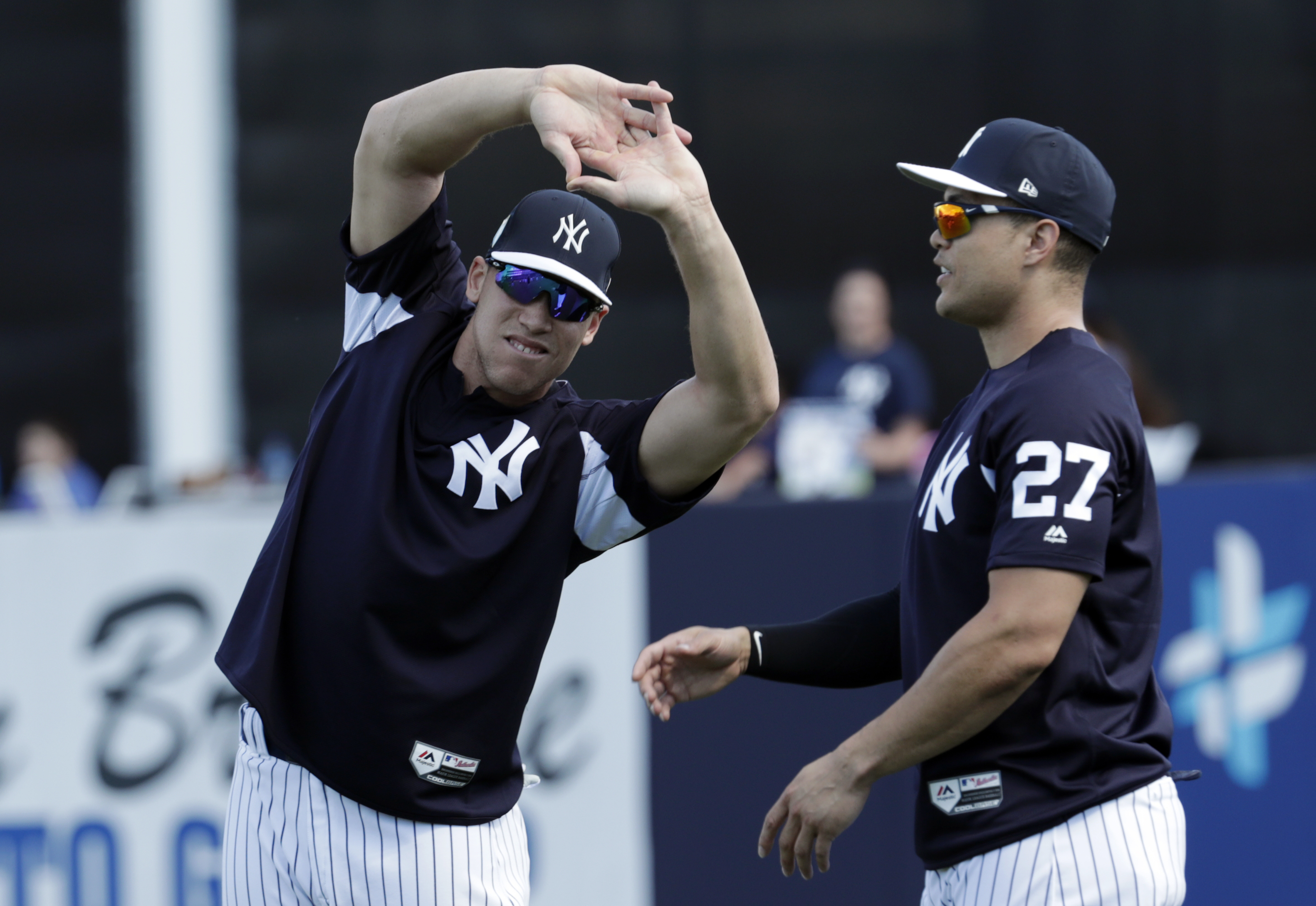 The Yankees´ Aaron Judge (left) and Giancarlo Stanton stretch at the team´s spring-training camp in Tampa.