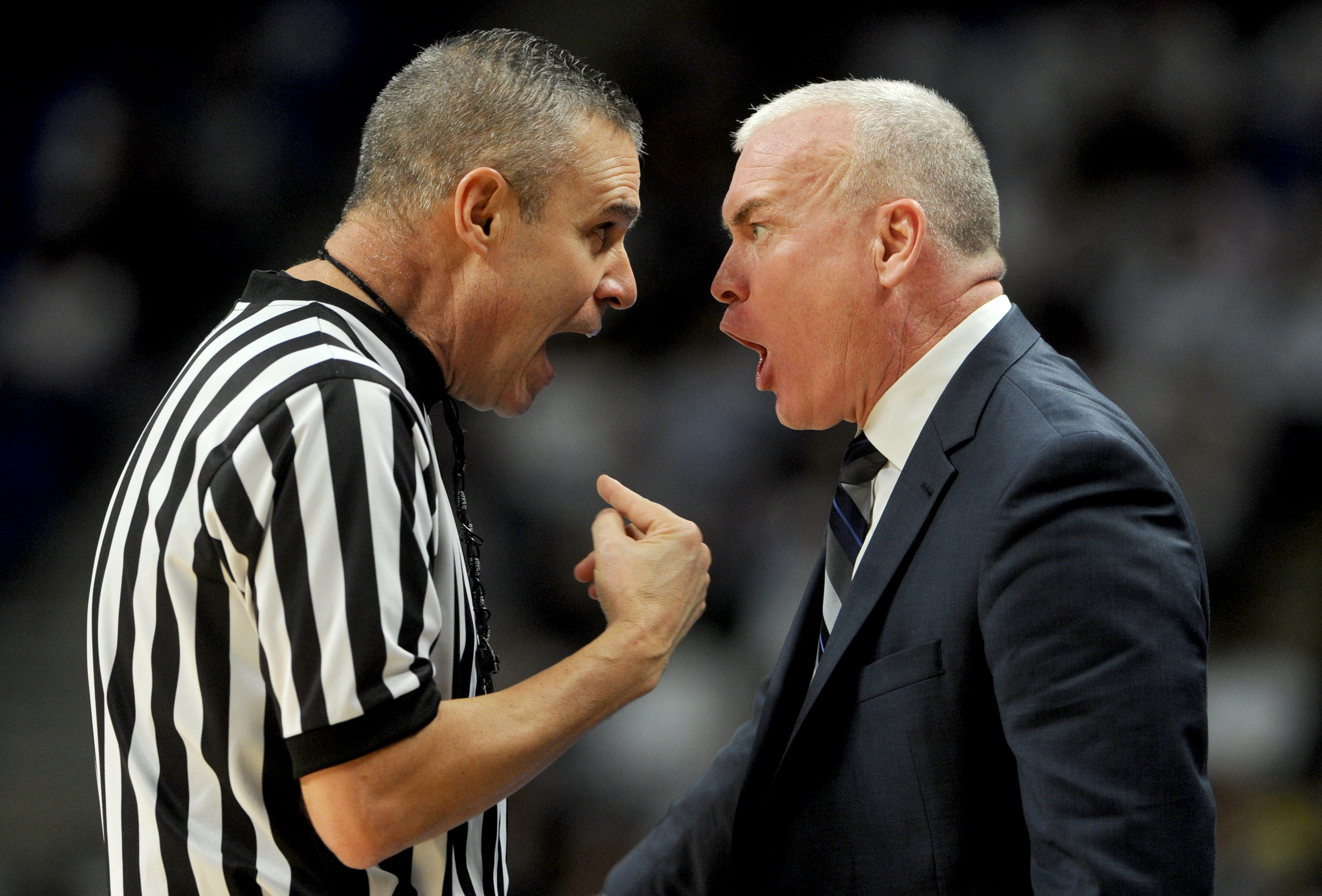 Penn State head coach Patrick Chambers, right, argues with a referee during the first half against Michigan on Wednesday, Feb. 21, 2018, at the Bryce Jordan Center in University Park, Mich. Michigan won, 72-63. (Abby Drey/Centre Daily Times/TNS)