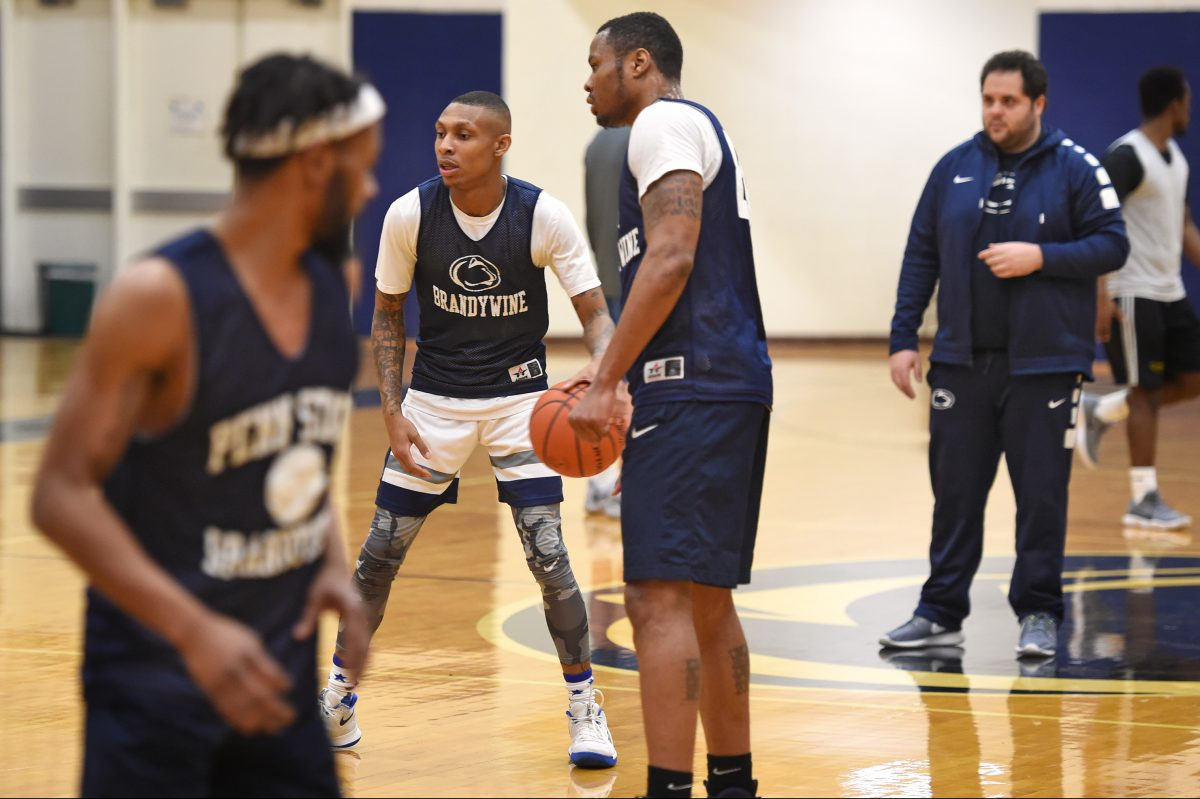 Penn State Brandywine head coach Ben Kay (right) at practice with seniors (from left) James Fisher, Donte Winfield, and Terrence Brown.