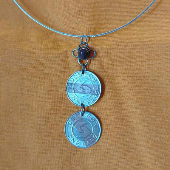A SEPTA token necklace selling for $20 on Token of Appreciation´s Etsy shop.