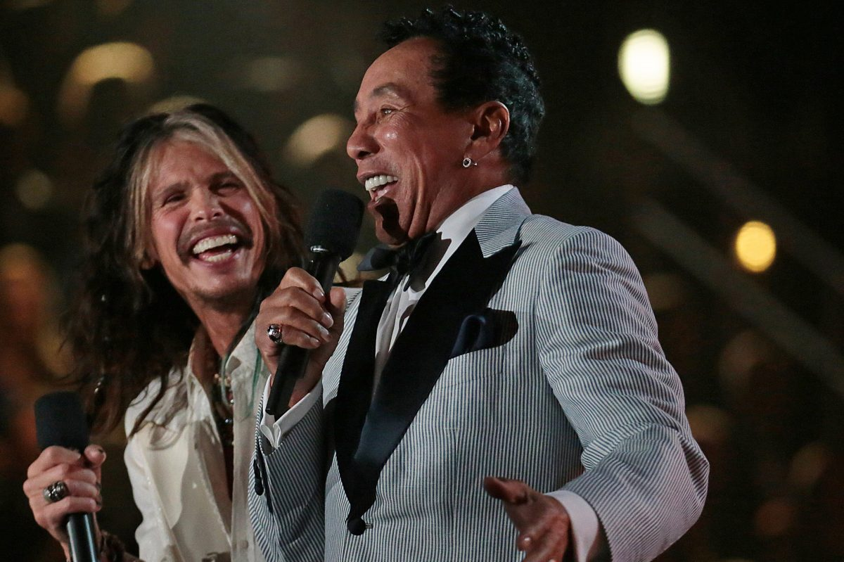 Steven Tyler and Smokey Robinson on stage to present at the 56th Annual Grammy Awards at Staples Center in Los Angeles on Sunday, Jan. 26, 2014.
