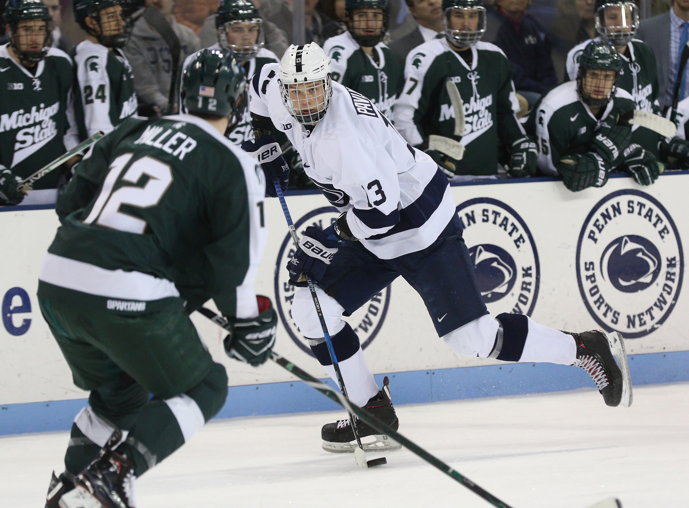 Penn State´s Nikita Pavlychev (13) carrying the puck against Michigan State on Nov. 24, 2017.