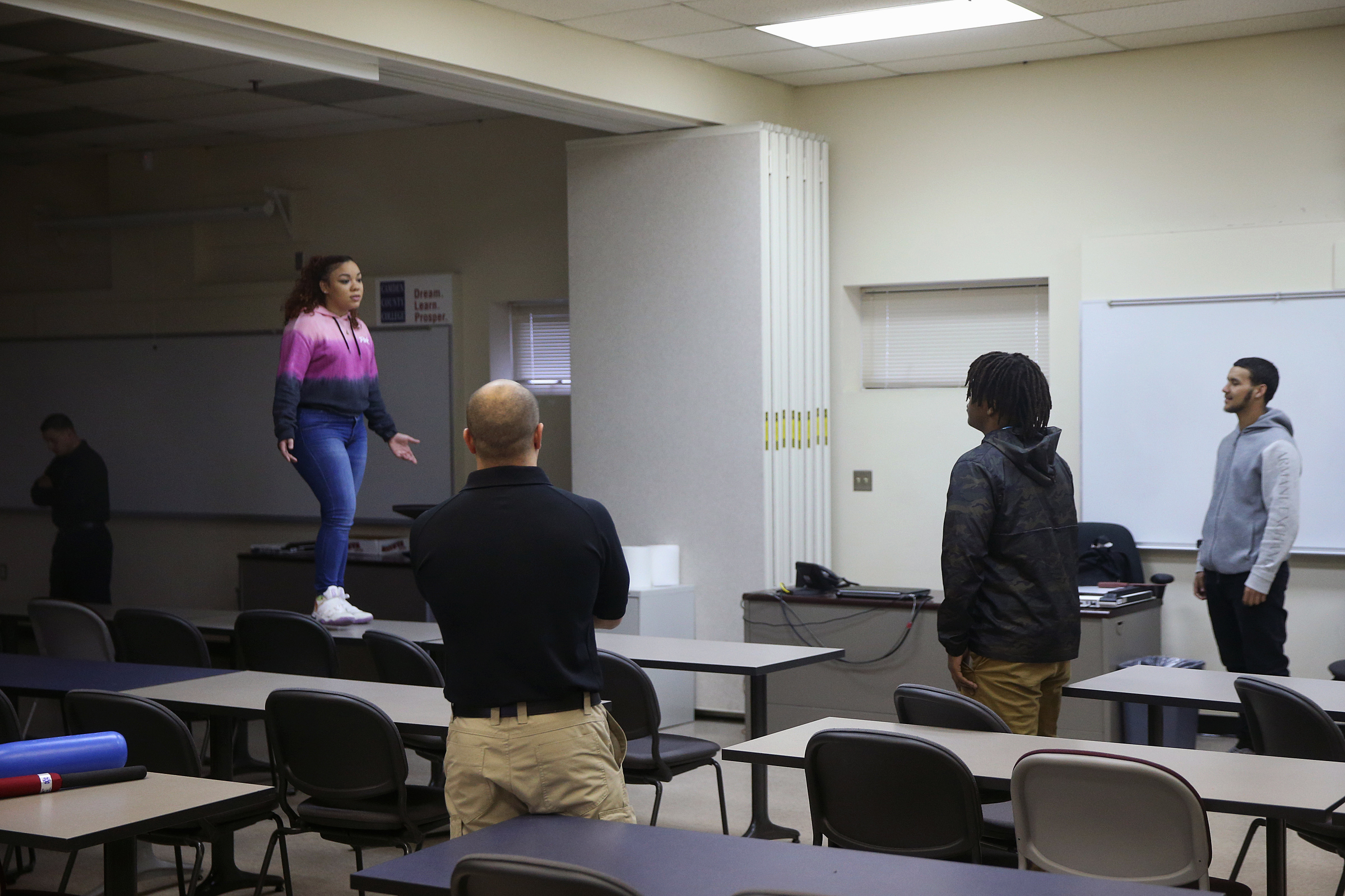From left, Officer Vilmary Otero role-plays a suicidal woman as Sgt. Chris Sarlo watches Woodrow Wilson High School senior Vaughn Williams, 18, and junior Jose Irene, 17, de-escalate the situation in a training exercise at the Camden County Police Academy in Blackwood, N.J., on Friday, March 2, 2018. Camden County police and Woodrow Wilson students are participating in a youth-police engagement program facilitated by the New York University School of Law´s Policing Project. TIM TAI / Staff Photographer