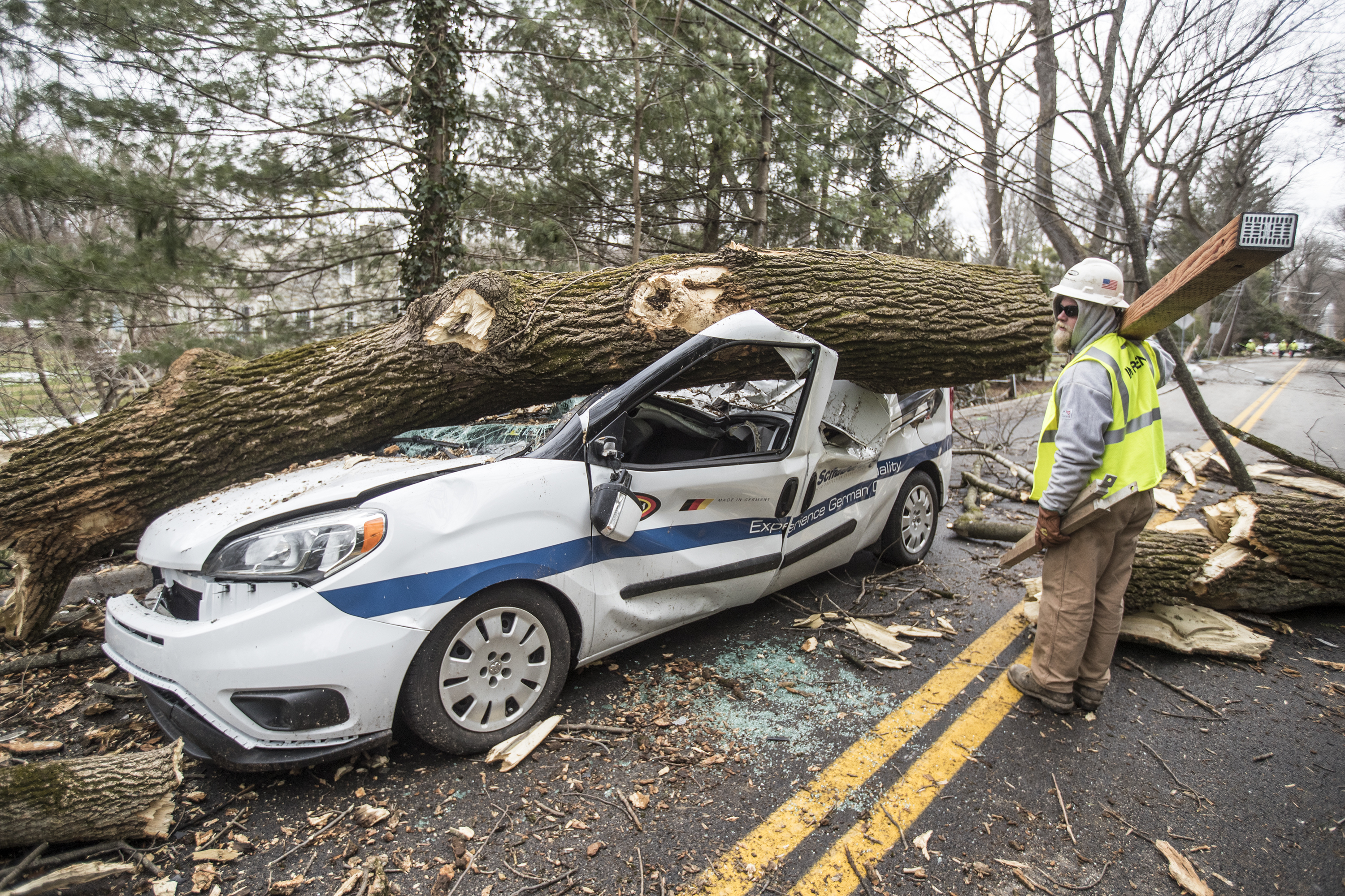 A car on Old Gulph Road in Bryn Mawr that was no match for what fell on it compliments of Friday´s nor´easter. MICHAEL BRYANT / Staff Photographer