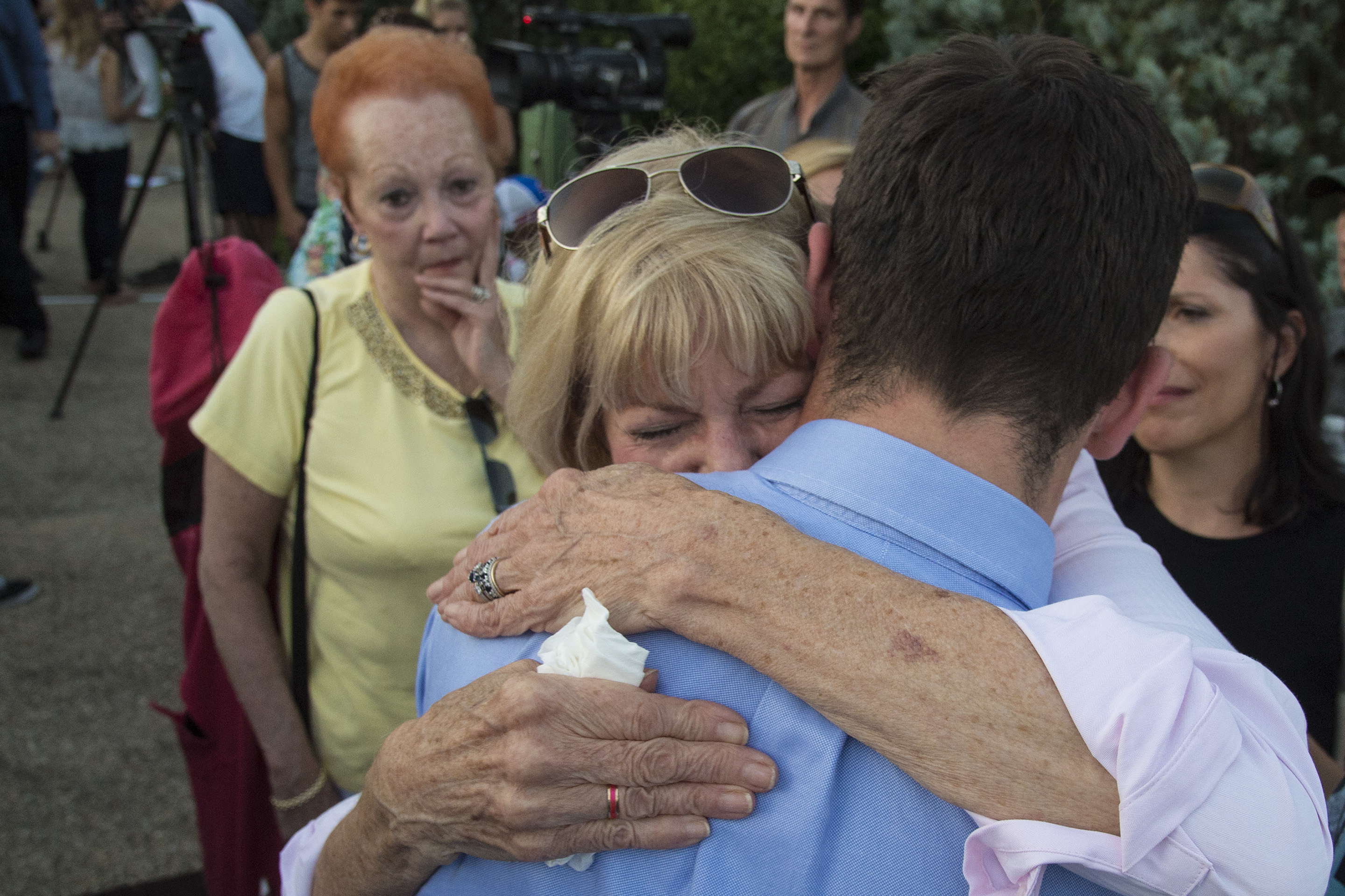 Sharon Patrick, grandmother and legal guardian of Jimi Patrick, who was murdered by Cosmo DiNardo, is embraced by a friend of Jimi's after a prayer and candlelight vigil for the four murdered men at the Garden of Reflection in Lower Makefield July 16, 2017. CLEM MURRAY / Staff Photographer