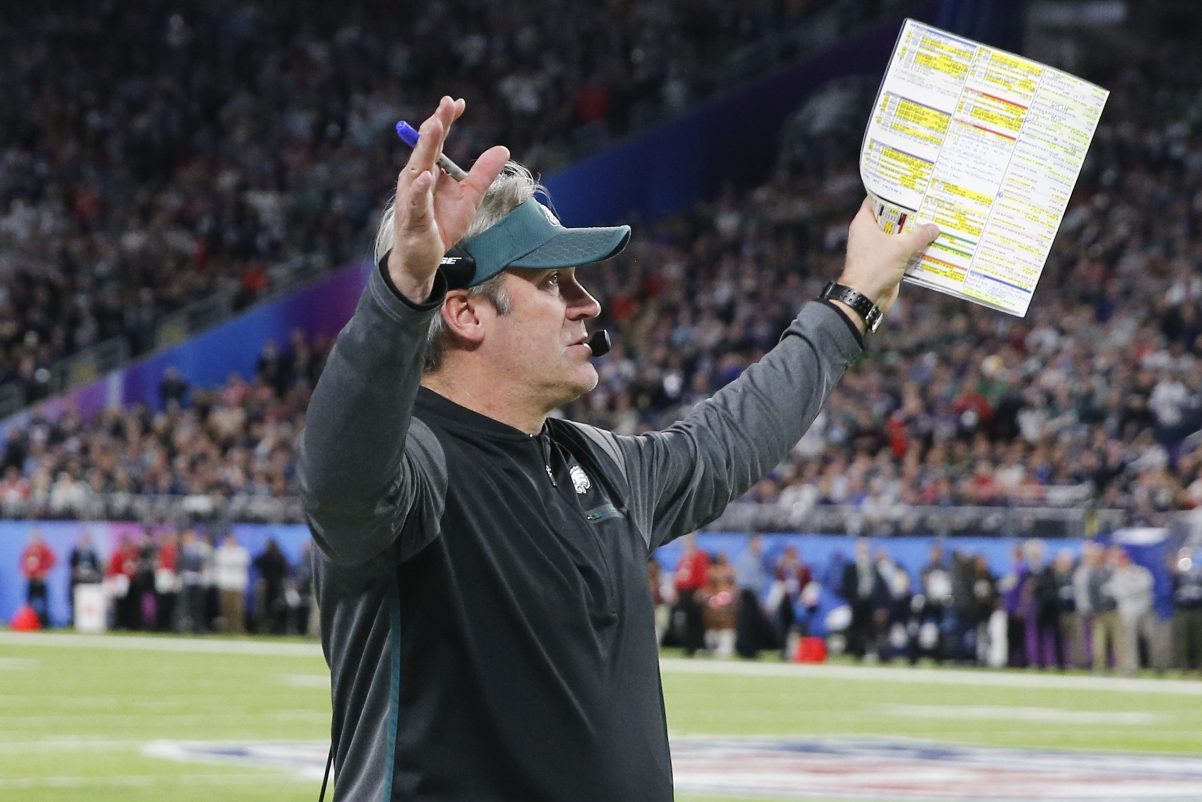 Eagles head coach Doug Pederson raises his arms after New England Patriots kicker Stephen Gostkowski misses a second-quarter field goal in Super Bowl LII on Sunday, February 4, 2018 in Minneapolis.