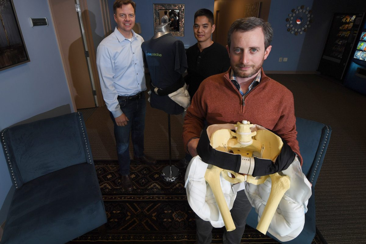 From left, Drew Lakatos, CEO, Wamis Singhatat, vice president of product development, and Zane McKinney, product specialist, with ActiveProtective's patented airbag belt, designed to prevent fall-induced hip fractures.