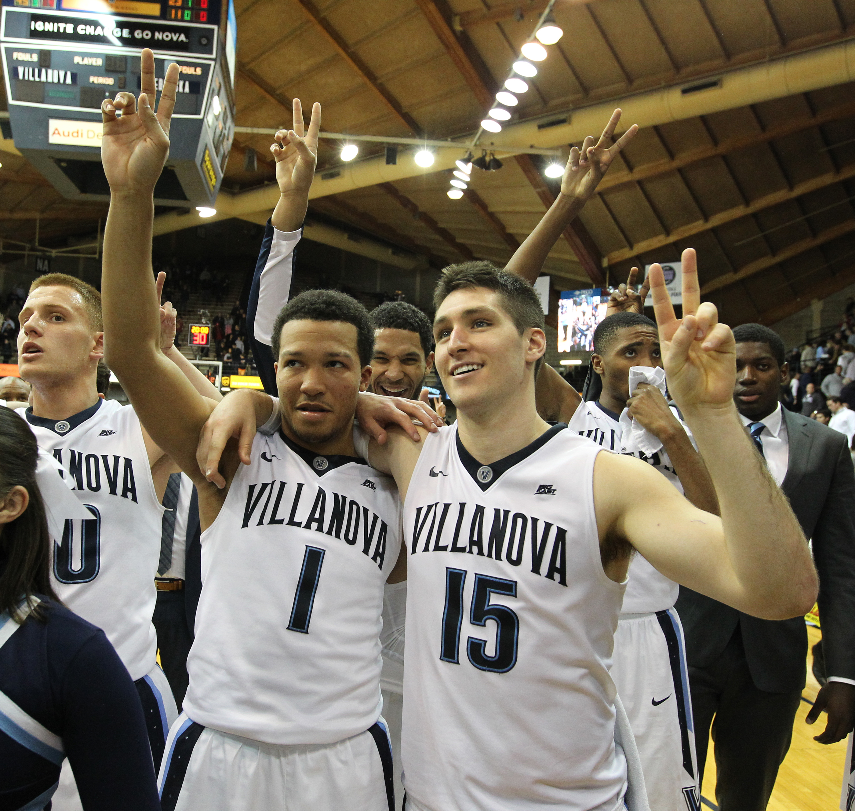 "Jalen Brunson #1, and Ryan Arcidiacono #15 of Villanova make the ""V"" sign as they stand in front of the student section after their 87-63 victory against Nebraska at The Pavilion at Villanova University on Nov. 17, 2015. The game is part of the inaugural Gavitt Tipoff Games between the Big East and the Big Ten."