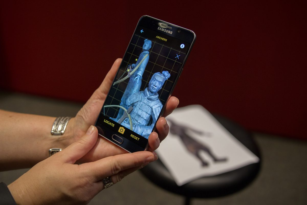Visitors to the Terraracotta Warriors exhibit can point their smartphone cameras at the figures to add missing details like a bow that they wielded, 2200 years ago.