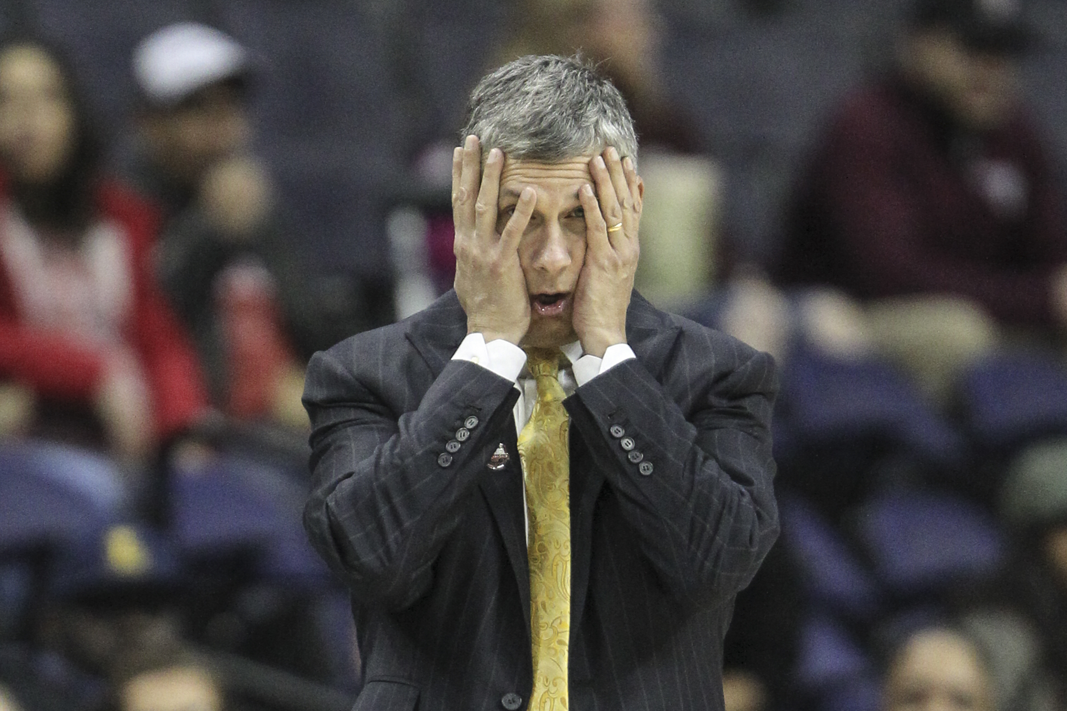 LaSalle´s head coach Dr. John Giannini covers his face down a few points against UMass during the 1st half of the A-10 tournament, first round, at the Capital One Arena, in Washington, DC, Wednesday, March 7, 2018. Umass beats LaSalle 69-67 to advance in the A-10 Tournament. STEVEN M. FALK / Staff Photographer