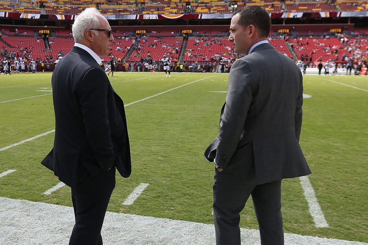 Howie Roseman (right) with Eagles owner Jeffrey Lurie before the win over Washington.