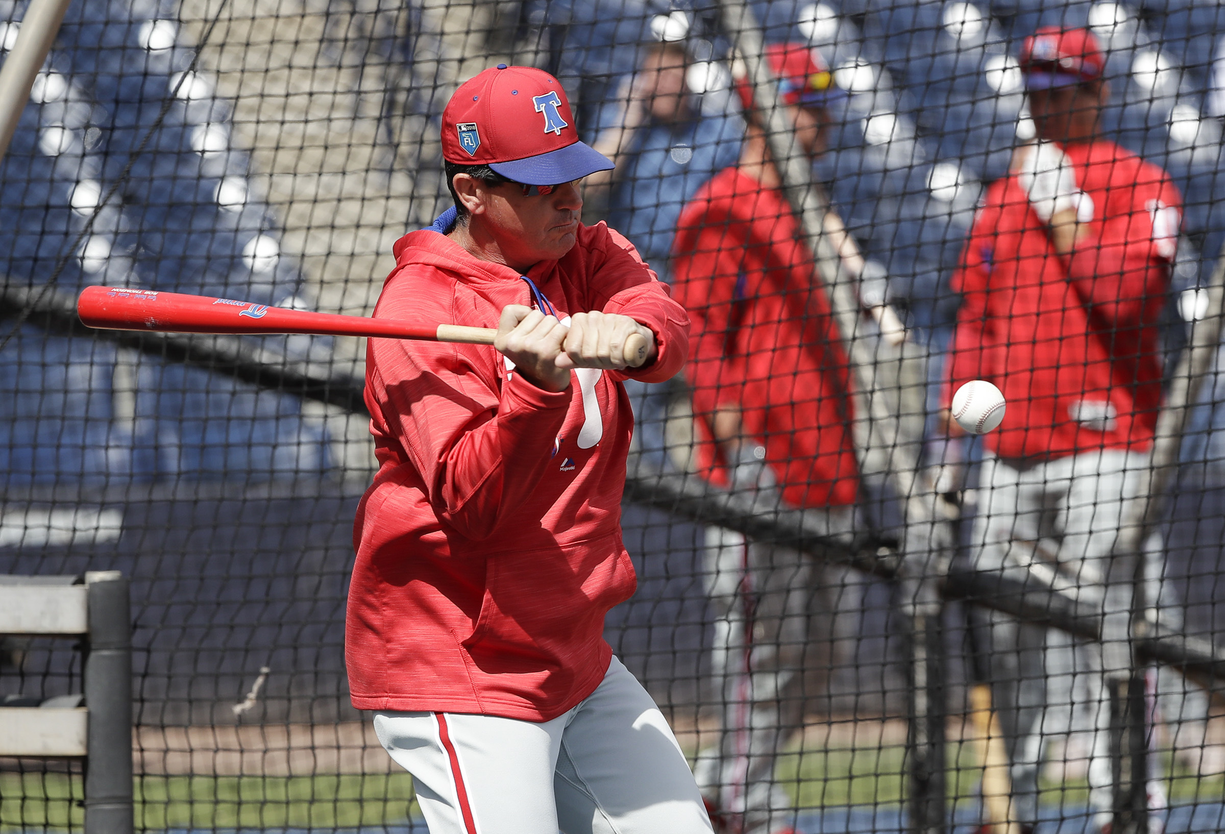 Phillies bench coach Rob Thomson hits the baseball during fielding drills before the Phillies play the New York Yankees in a spring training game at George M. Steinbrenner Field in Tampa on Thursday, March 8, 2018.