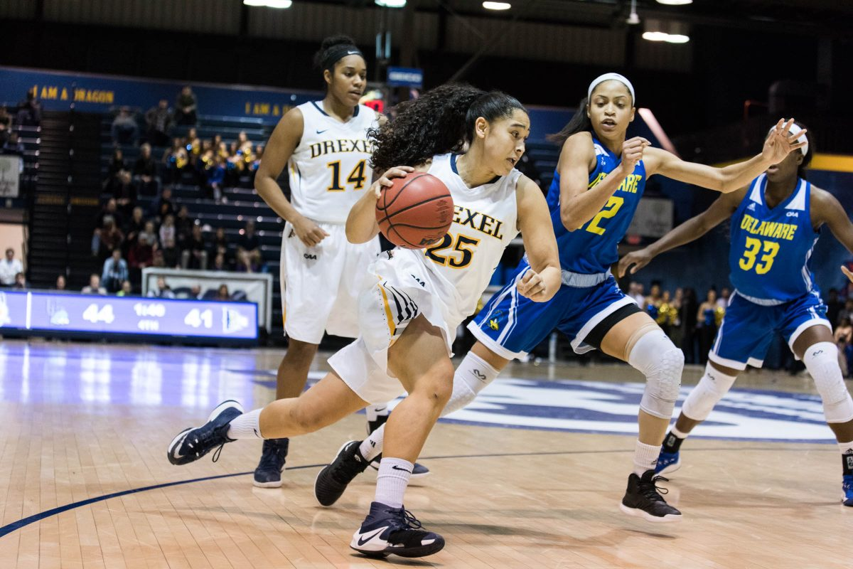 Drexel senior forward Kelsi Lidge dribbles past Delaware players during the second half of Drexel's 58-53 overtime win over Delaware in the CAA women's basketball tournament at Daskalakis Athletic Center on Friday, March 9, 2018.