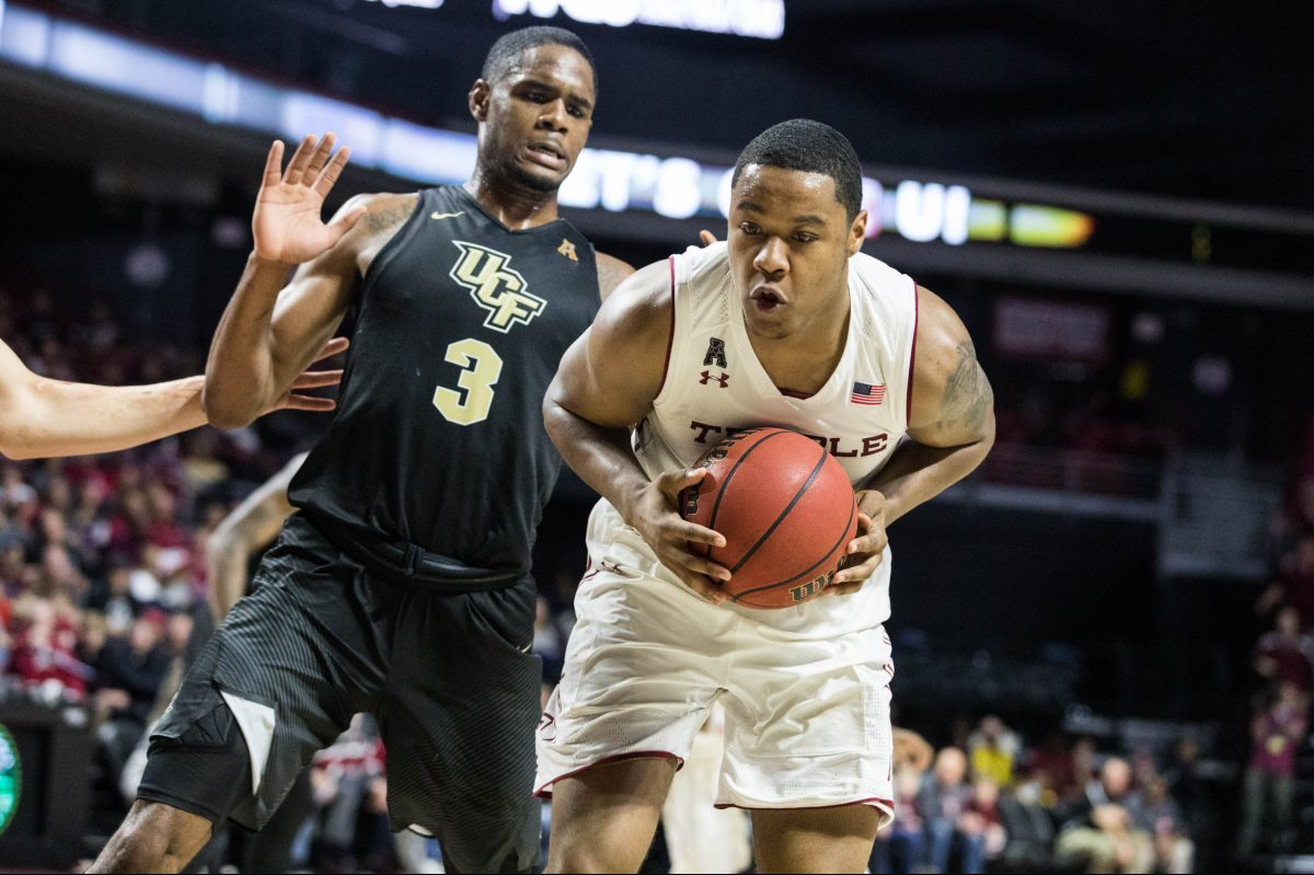 Freshman forward J.P. Moorman II keeps the ball away from UCF redshirt-senior guard-forward A.J. Davis before making a pass during the second half of Temple´s 75-56 win over UCF at The Liacouras Center on Sunday, February 25, 2018.