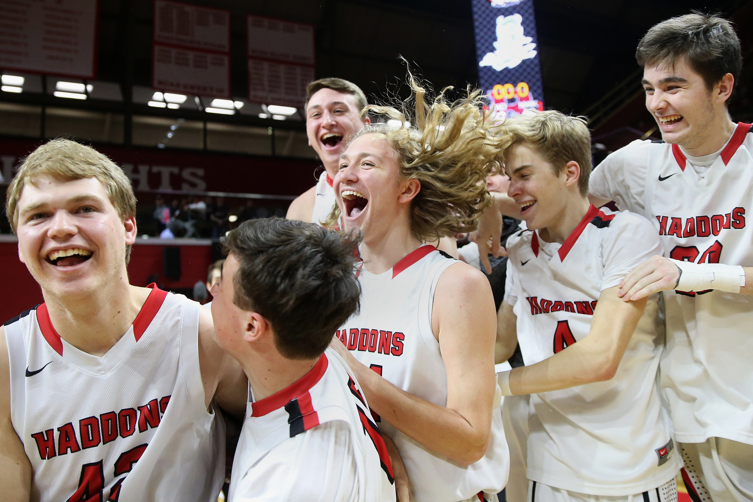 Haddonfield players celebrate Group 2 state title in basketball.