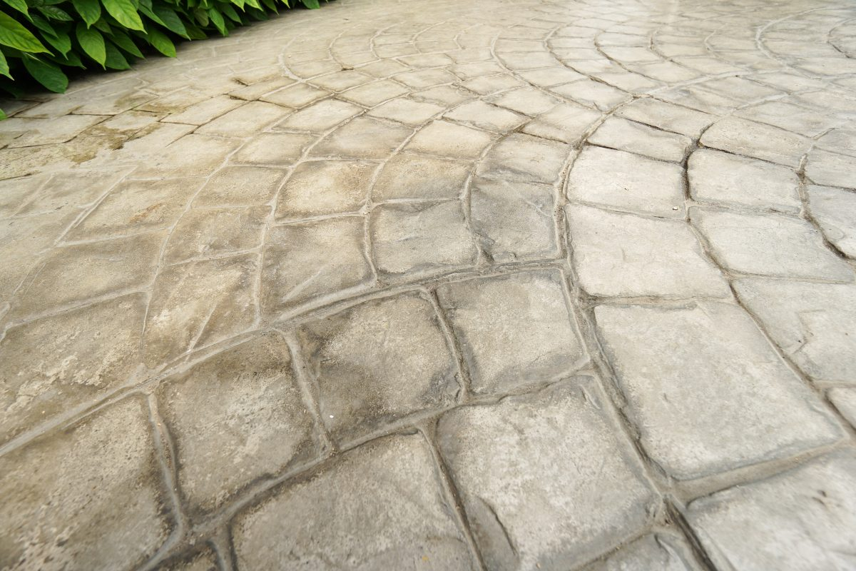 "A stamped concrete floor can be installed over existing or new concrete. It involves spreading new concrete and using tools like act like a big cookie cutter to create textured impressions and ""grout"" lines."