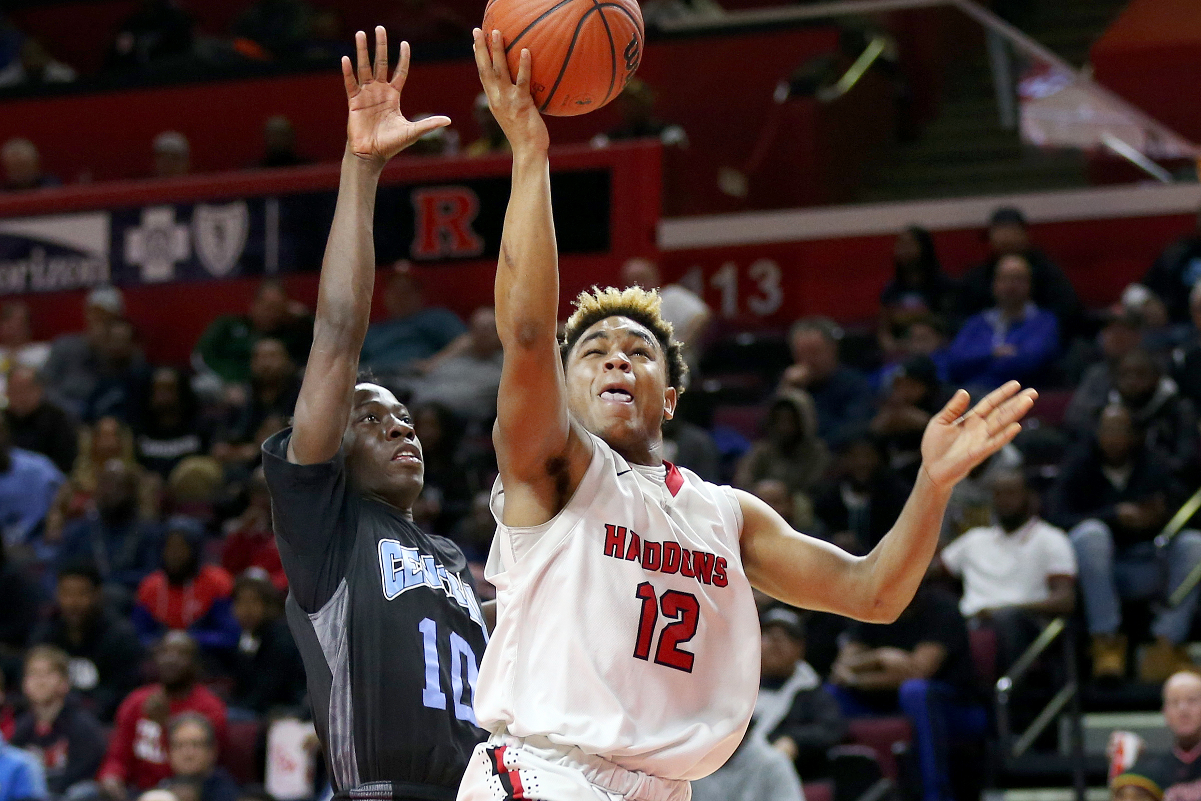 Haddonfield´s Lewis Evans (12) puts the ball up past Newark Central´s Joel Uzoka-Simmons (10) during the Group 2 state championship game.