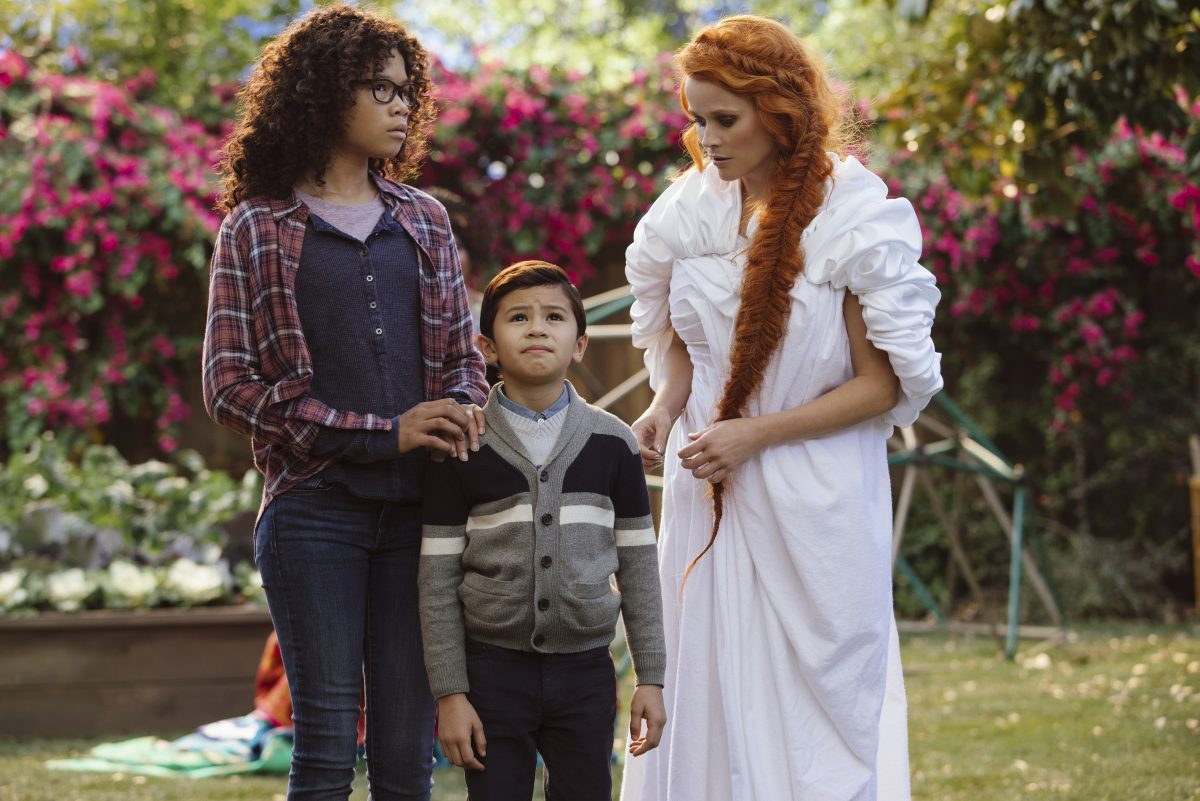 Storm Reid, (Meg) Deric McCabe (Charles Wallace) and Reese Witherspoon (Mrs. Whatsit)  in a scene from A Wrinkle In Time.