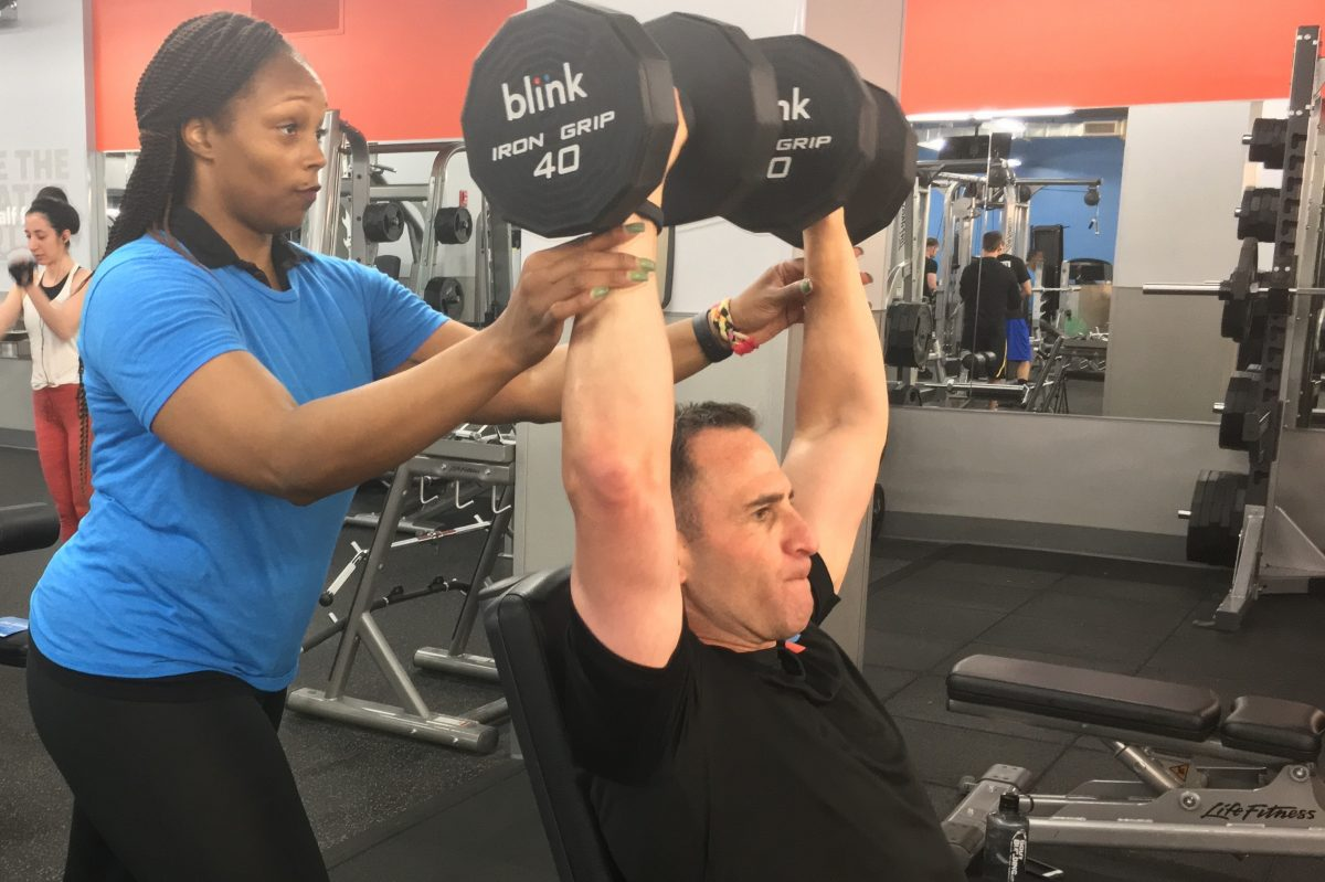 Blink President Todd Magazine with his trainer at a recent workout. He said studio gyms are popular because people want a healthier lifestyle.