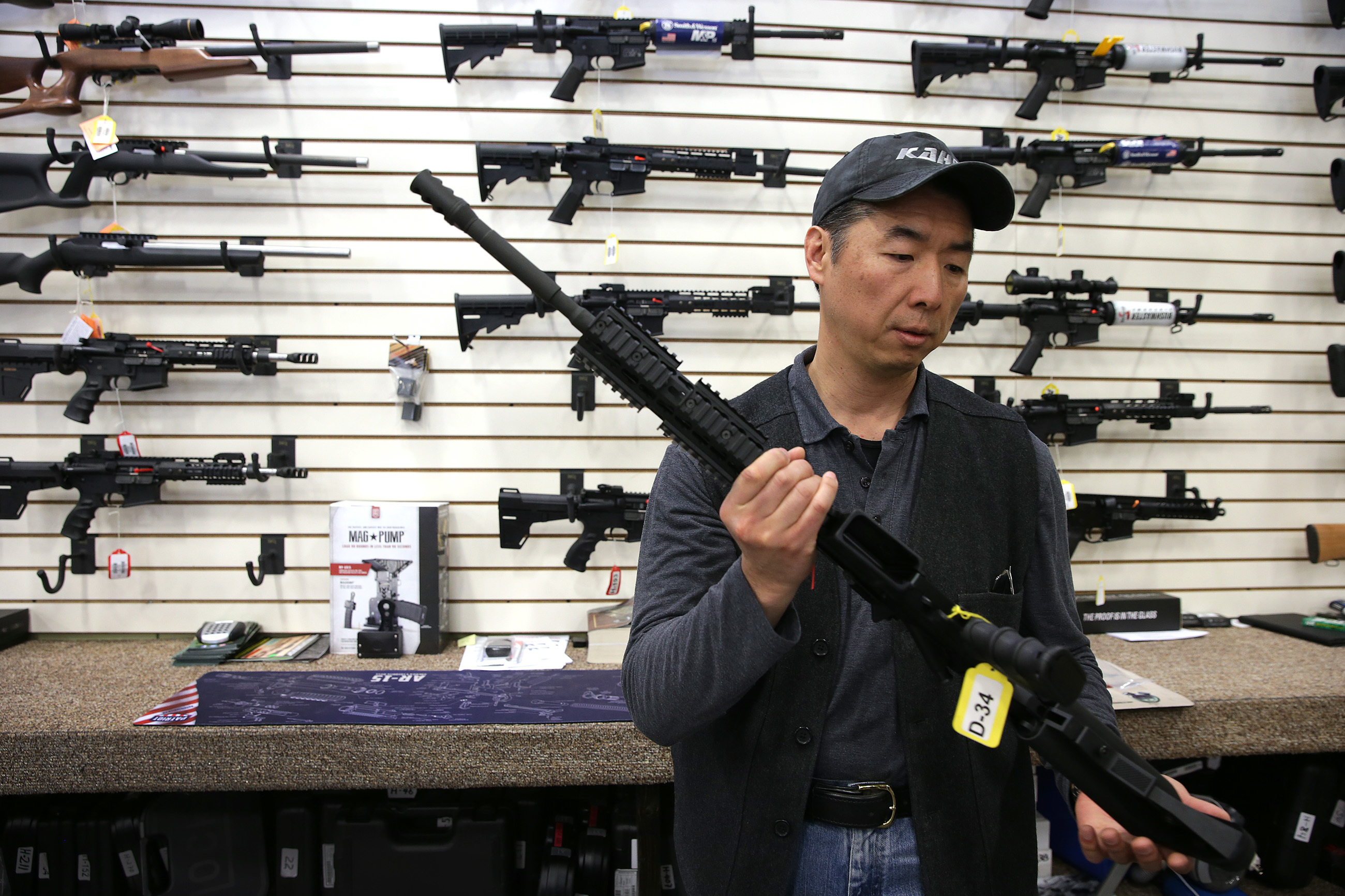 Justin Moon, owner of Kahr Arms, talks about an AR-15 in their retail shop at their corporate headquarters in Greeley, PA on March 9, 2018. The AR-15 was made by his company. DAVID MAIALETTI / Staff Photographer