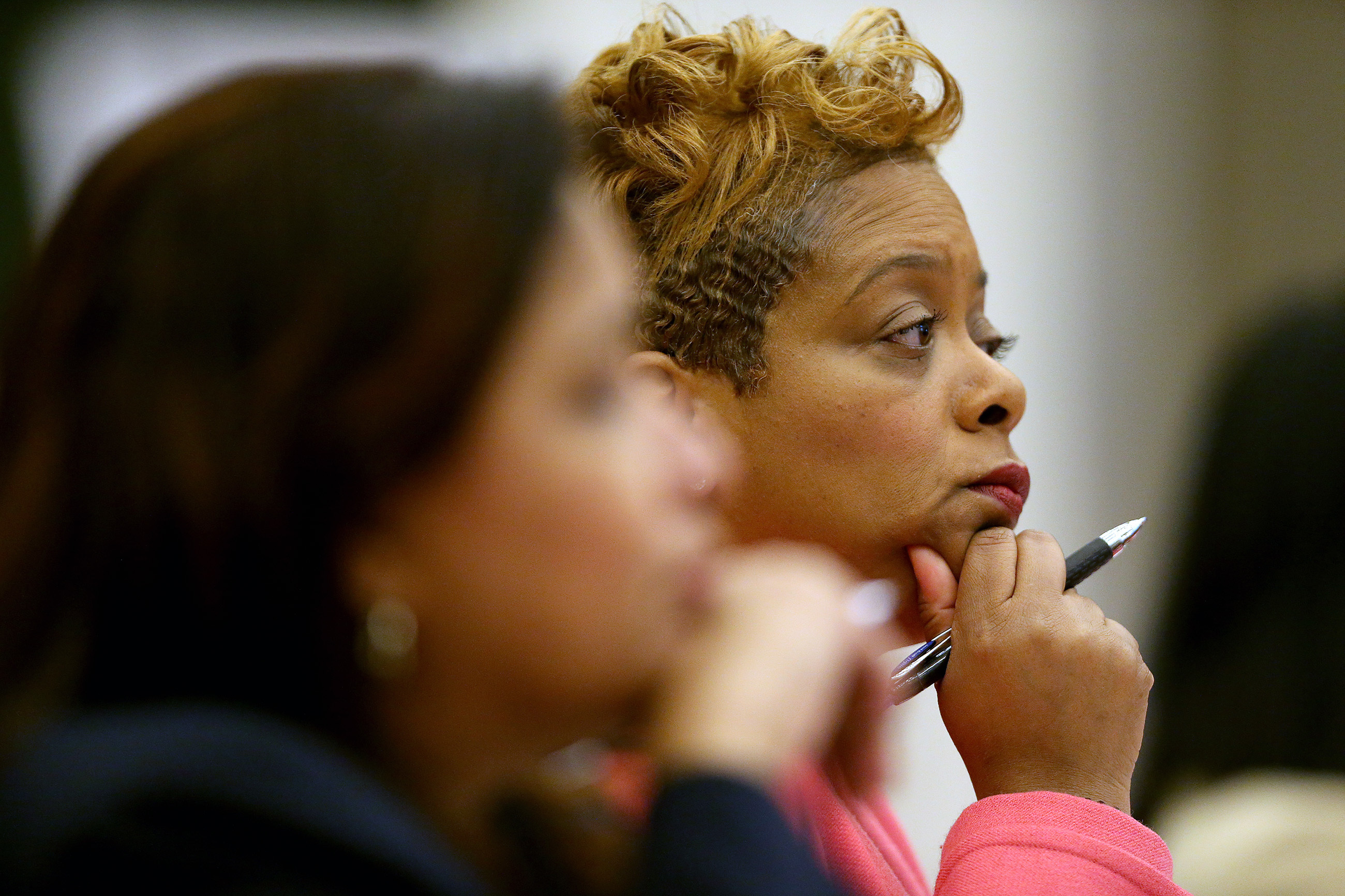 Councilwoman Cindy Bass, right, listens during City Council hearing on the opioid crisis at City Hall in Philadelphia, PA on March 12, 2018.