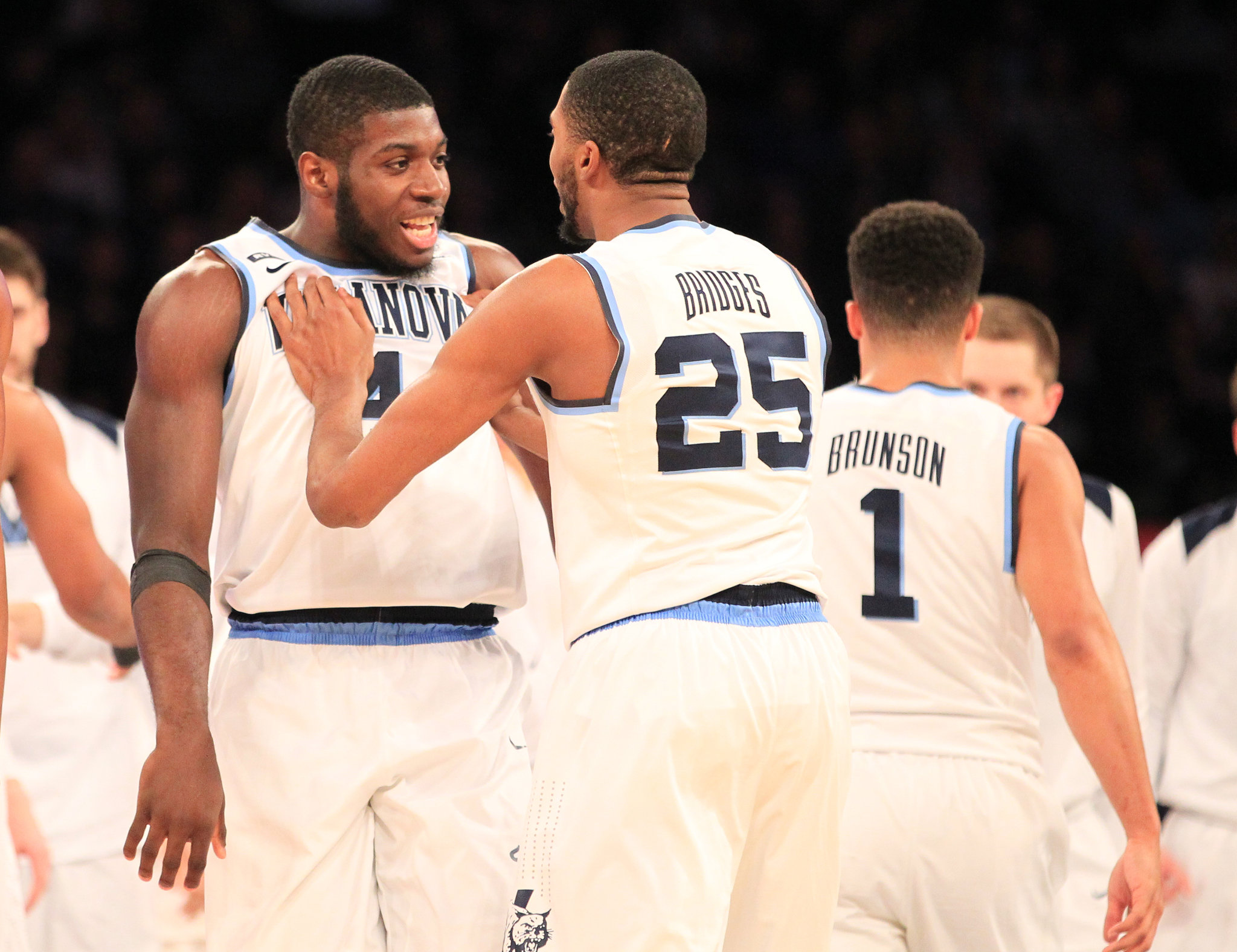 Eric Paschall, left, and Mikal Bridges of Villanova celebrate after a Bridges 3-pointer forced Providence to call a timeout during the 1st half in the Big East Tournament Championship Game at Madison Square Garden on March 10, 2018.