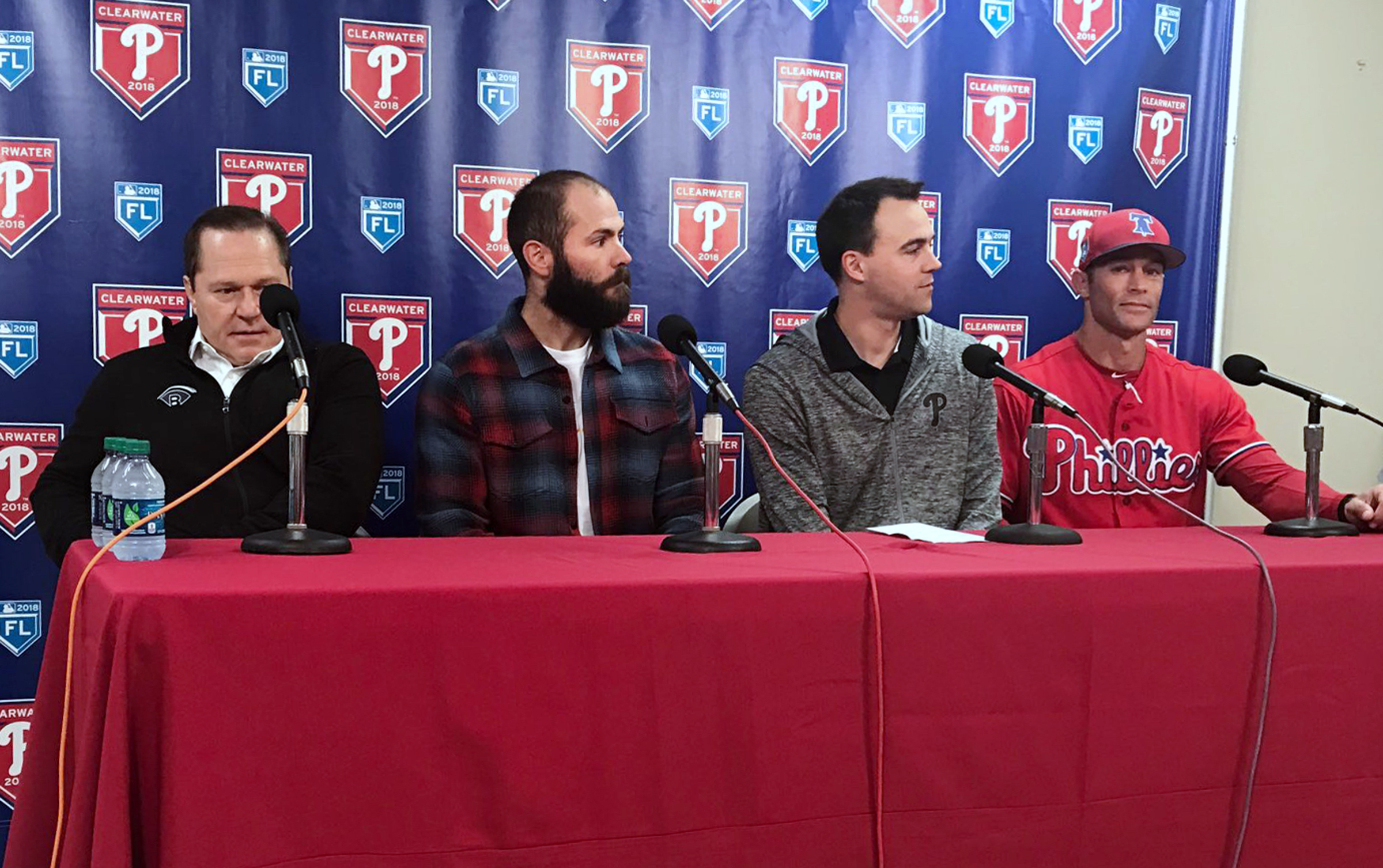 New Phillies pitcher Jake Arrieta (second from left) at his introductory press conference Tuesday with (from left) agent Scott Boras, Phillies general manager Matt Klentak and Phillies manager Gabe Kapler.
