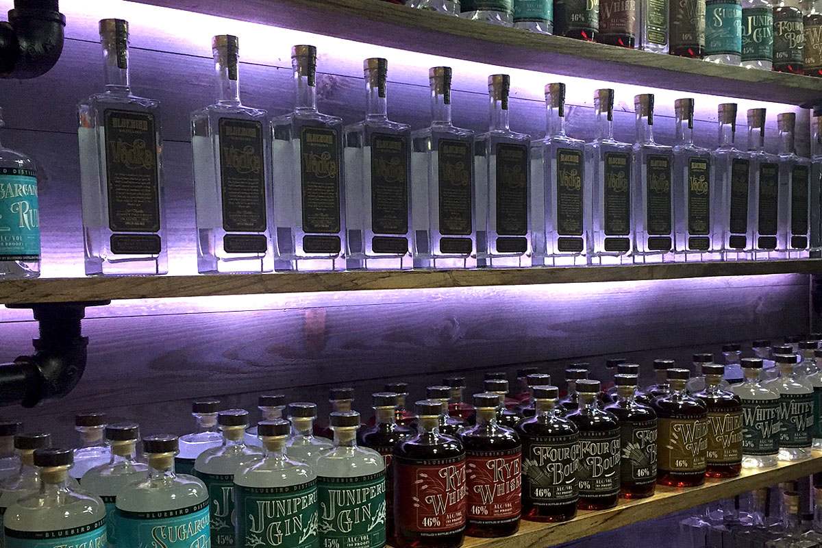 Bottles on the wall at Bluebird´s tasting room at Liberty Place.