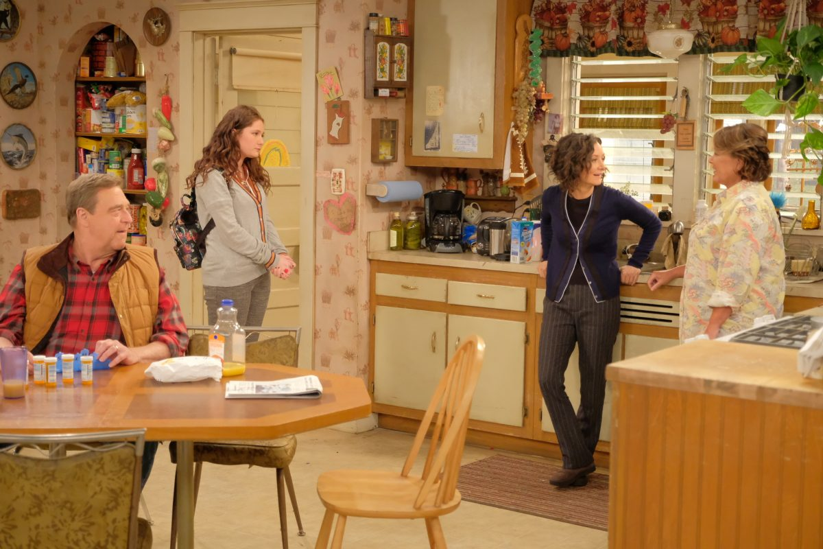 """John Goodman (left) with Emma Kenney, Sara Gilbert, and Roseanne Barr in a scene from ABC's """"Roseanne,"""" which returns with nine new episodes beginning March 27"""