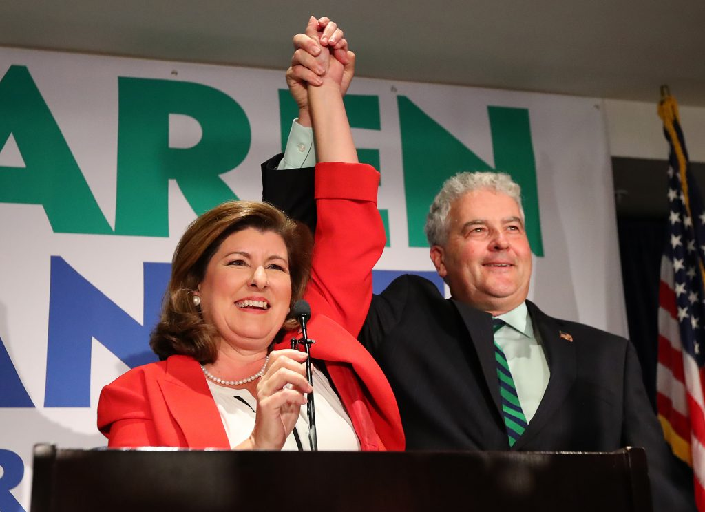 Republican candidate Karen Handel and her husband, Steve, celebrate her victory. (CURTIS COMPTON /Atlanta Journal-Constitution)