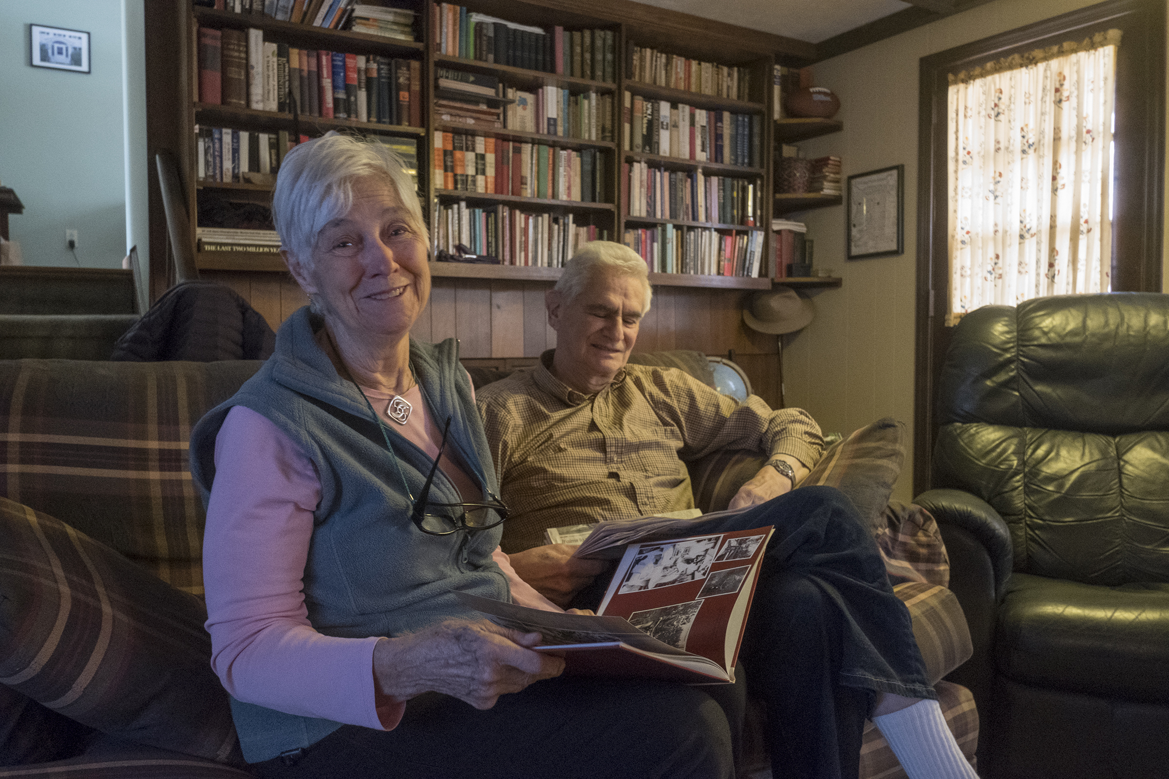 Ron, 81, and Joy Pott, 80 relax in their family room as they watch a college basketball game.