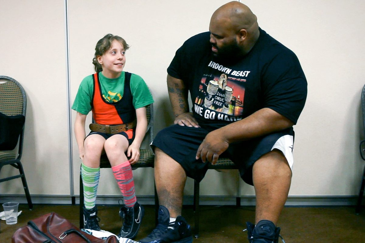 Naomi Kutin and a fellow powerlifter at a competition
