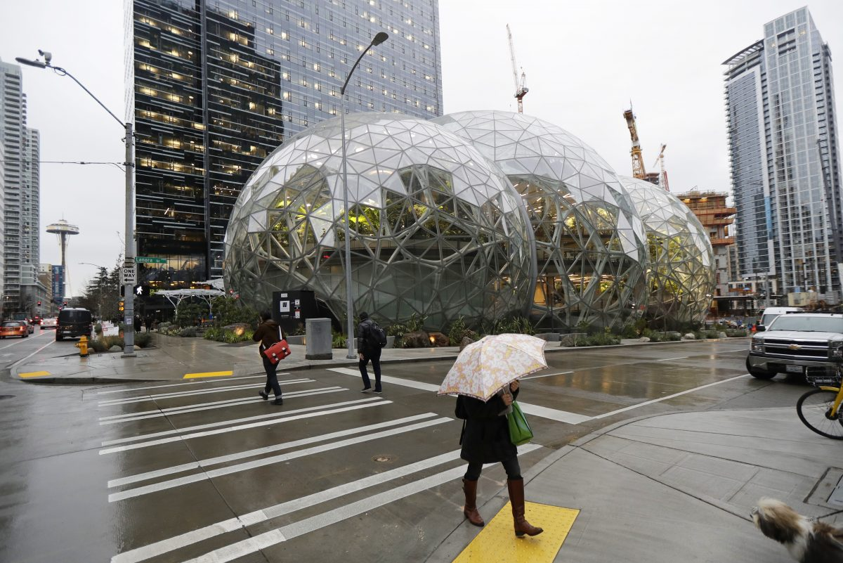 Pedestrians walk past the Amazon Spheres at the company's headquarters in downtown Seattle.
