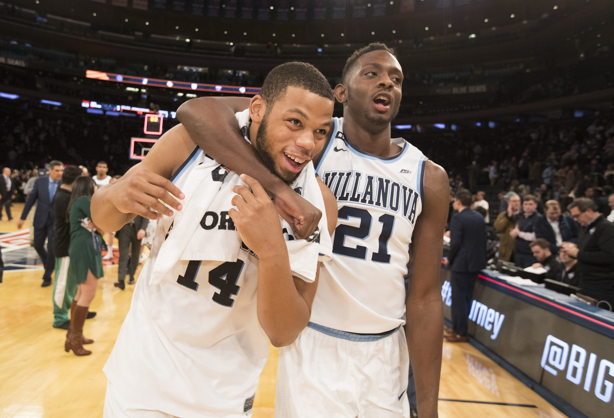 Omari Spellman, left, and Dhamir Cosby- Roundtree of Villanova leave the court in a jovial manner after defeating Butler in the Big East Tournament semi-finals at Madison Square Garden on March 9, 2018