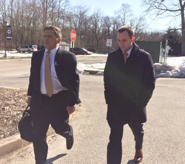 Kevin Gaughan, 30, of Paoli (right) with his West Chester attorney, Robert Donatoni, turns himself in to Radnor police.