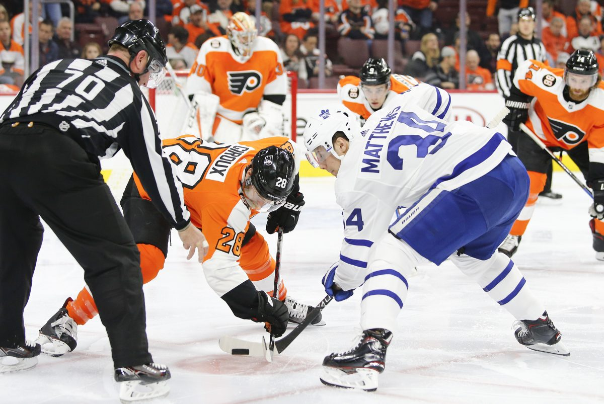 Flyers center Claude Giroux takes a faceoff against Maple Leafs center Auston Matthews. Giroux is one of the NHL's best.