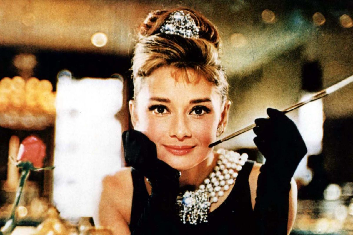 """This undated file photo released by Christie´s auction house Tuesday, Oct. 10, 2006, shows actress Audrey Hepburn in the 1961 film, """"Breakfast at Tiffany´s."""" The black Givenchy dress sold at auction Tuesday, Dec. 5, 2006 for 410,000 pounds (US$807,000, euro607,000)."""