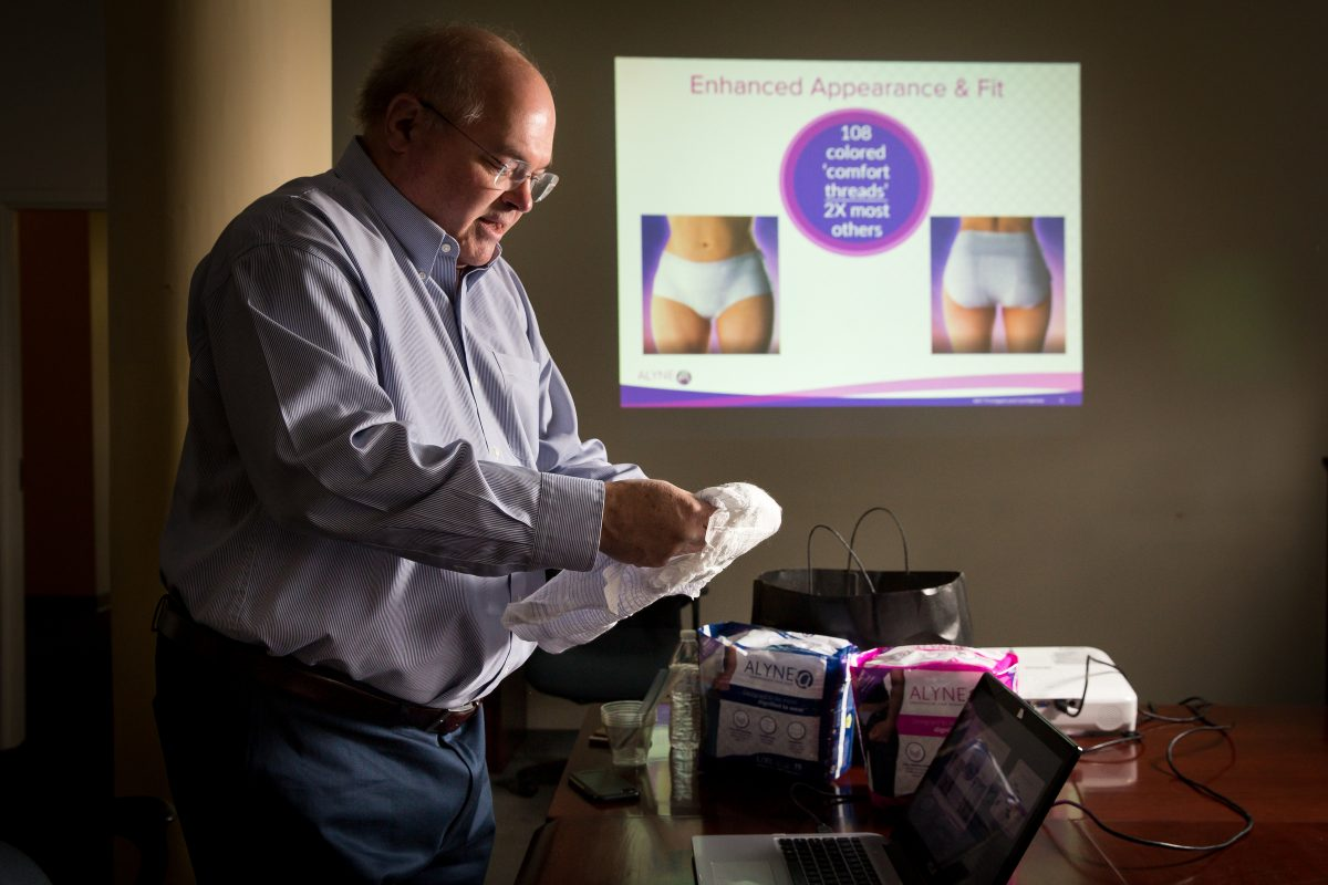 Joe Howard, president and CEO of Advanced Absorbent Technologies LLC, demonstrates his company's product,  more comfortable and dignified adult protective underwear.