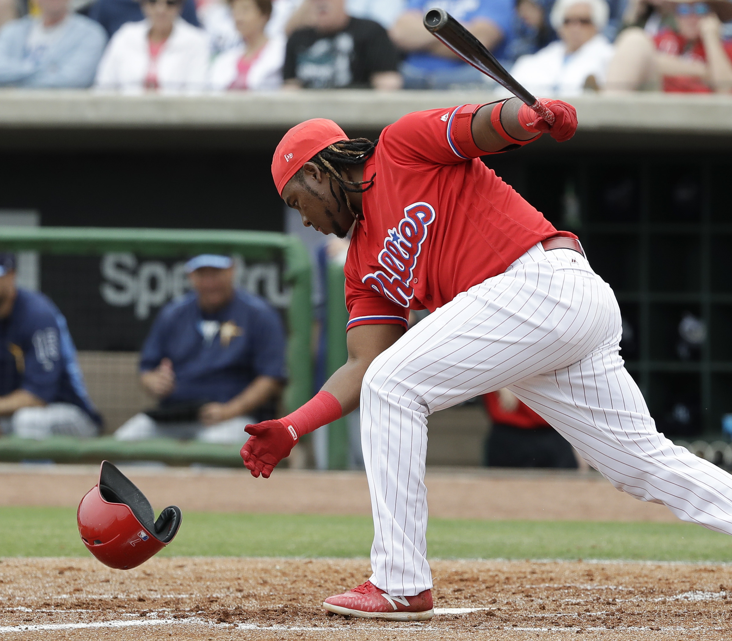 Phillies Maikel Franco loses his batting helmet striking out swinging in the second-inning against the Tampa Bay Rays during a spring training game on Saturday.