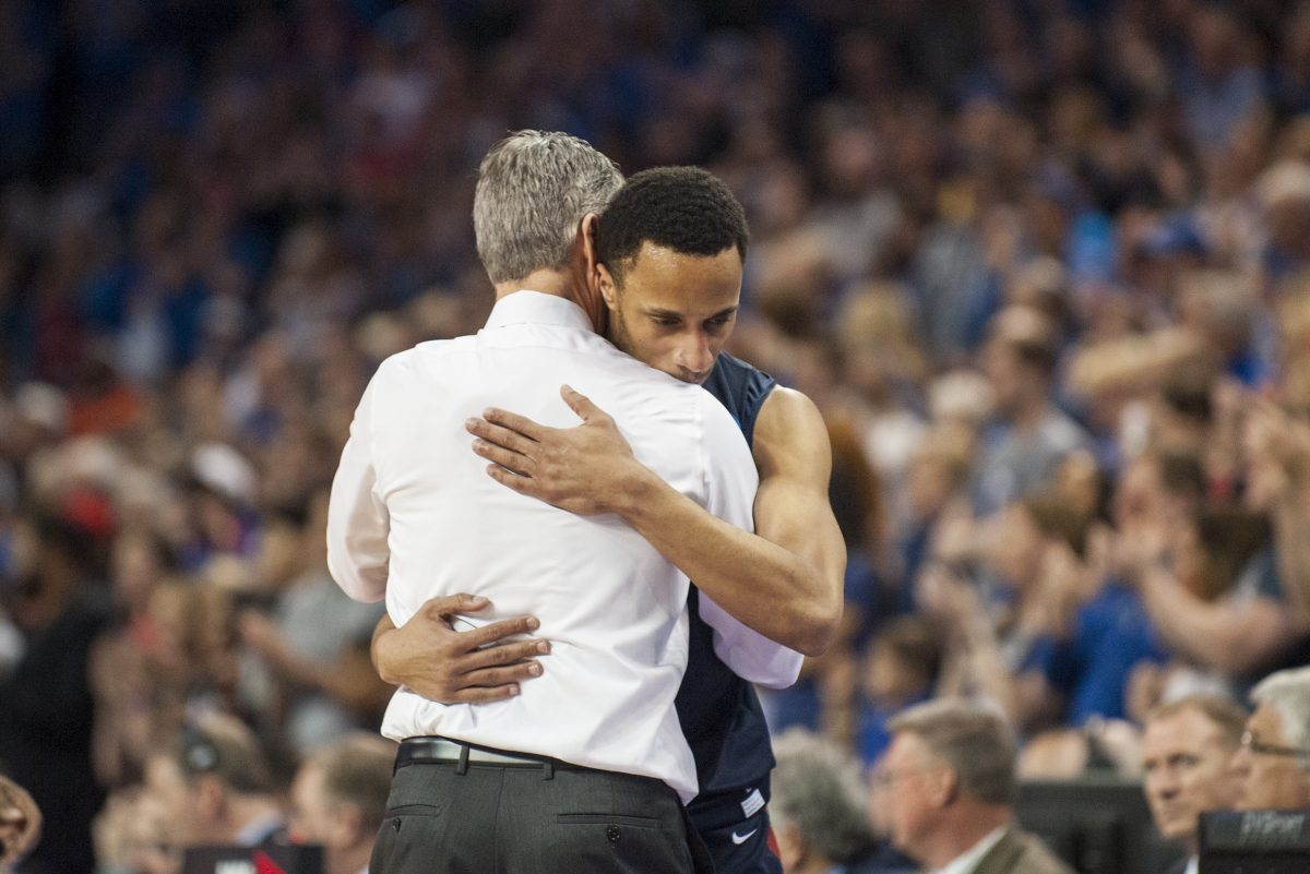 Penn Quakers head coach Steve Donahue hugs Penn Quakers guard Darnell Foreman (4) at the end of the First Round game against the Kansas Jayhawks in the 2018 NCAA Men´s Basketball Tournament Thursday, March 15, 2018 at Intrust Bank Arena in Wichita, Kan.