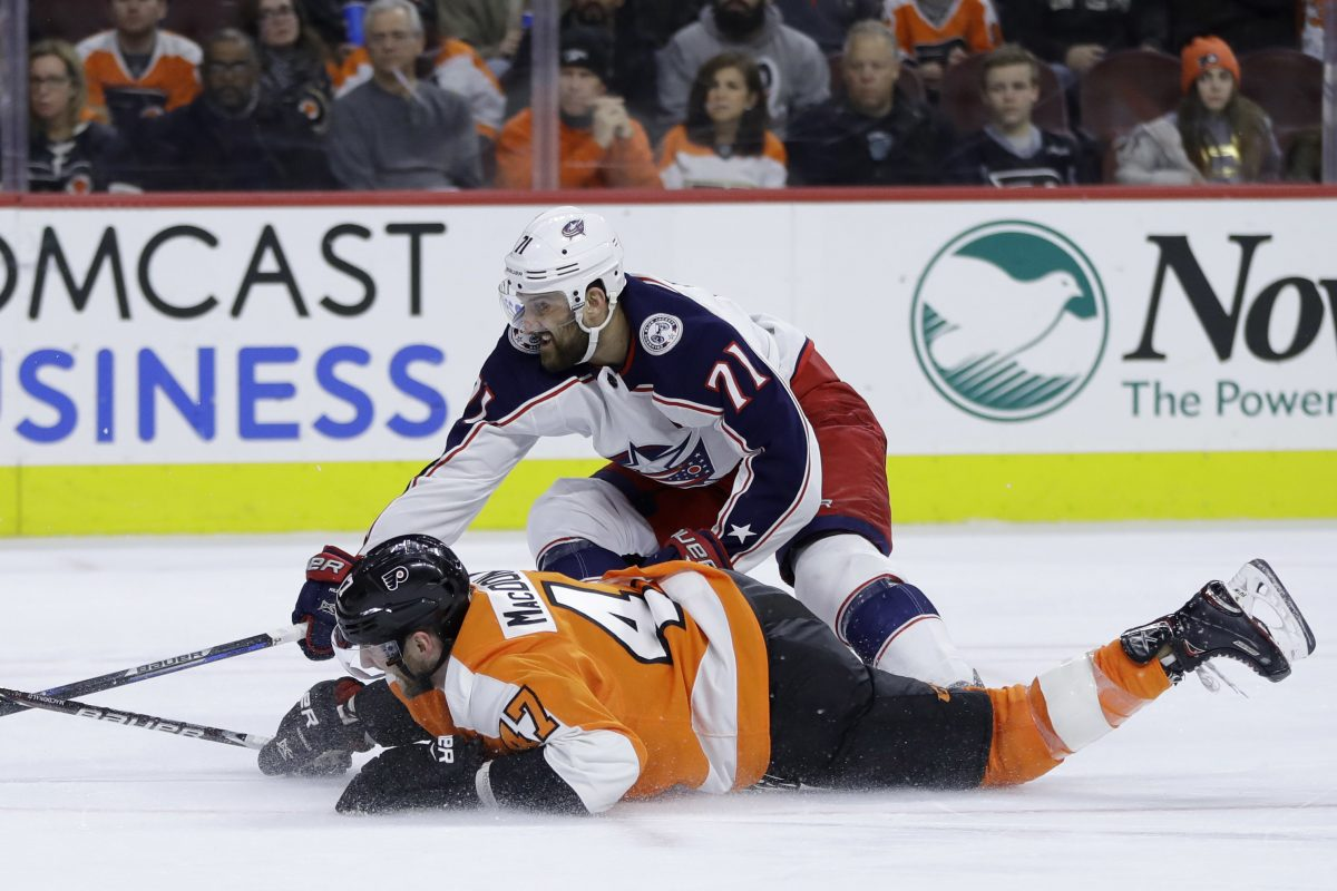 Flyers defenseman Andrew MacDonald (bottom) and Blue Jackets forward Nick Foligno battle for the puck during the third period of the Flyers' loss.
