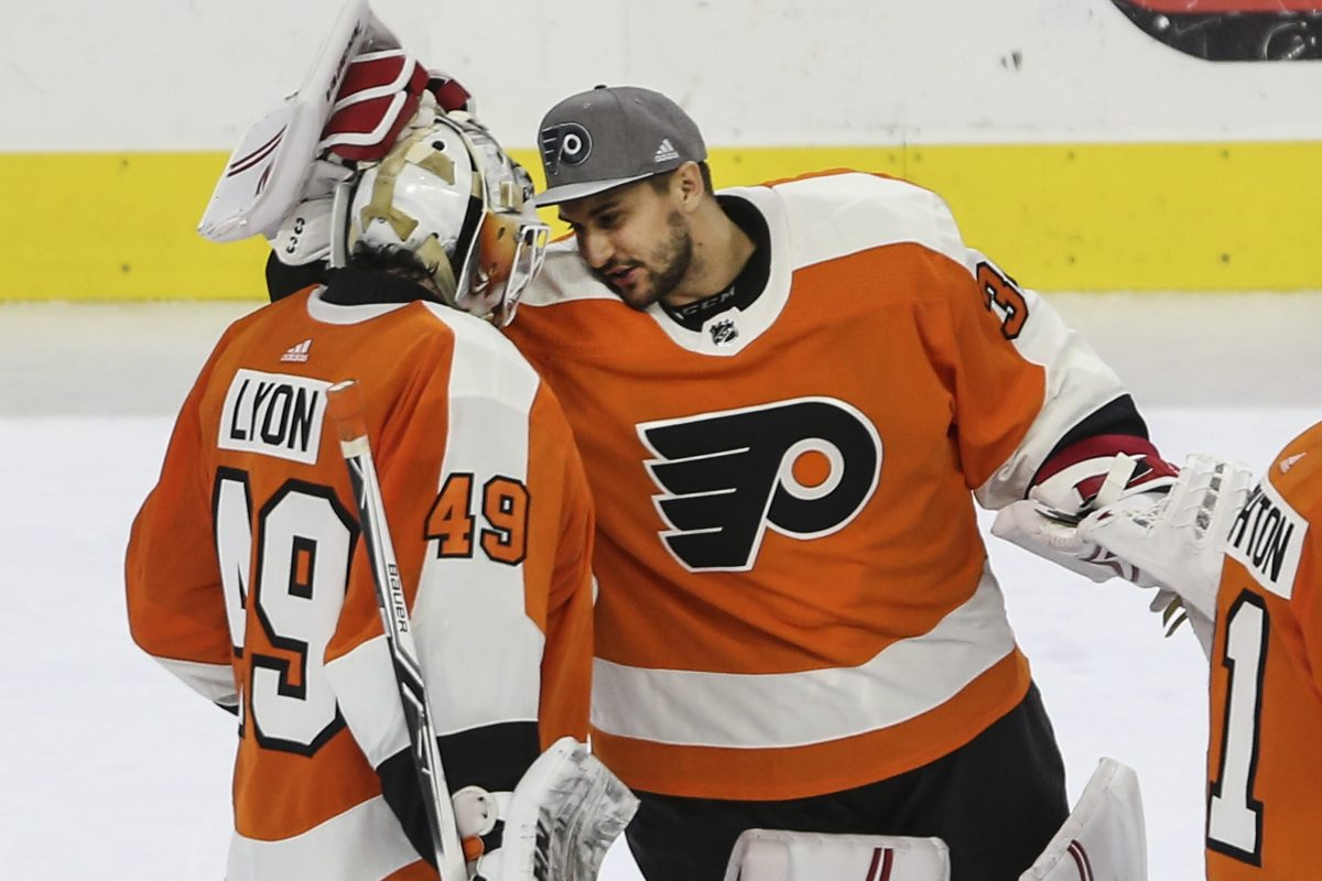 Flyers' new goalie Petr Mrazek celebrates with goalie Alex Lyon after beating the Canadiens in overtime 3-2 at the Wells Fargo Center on February 20.