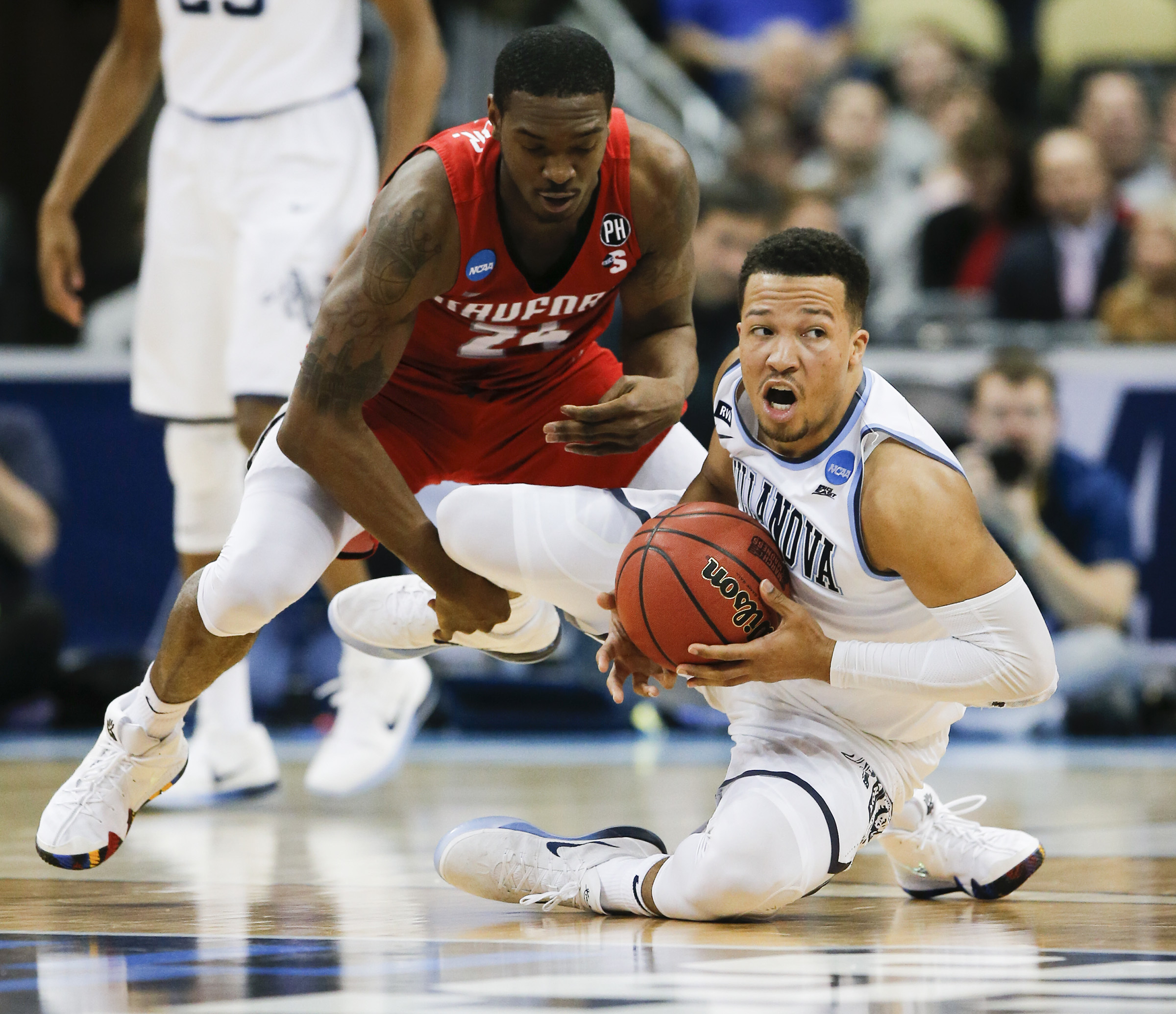 Villanova guard Jalen Brunson grabs the basketball past Radford forward Ed Polite Jr., during the second-half in the first round of the NCAA Men´s Basketball Tournament on Thursday, March 15, 2018 at PPG Paints Arena in Pittsburgh. YONG KIM / Staff Photographer
