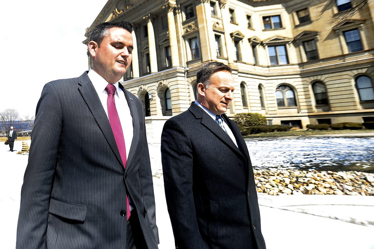 State Represenative Nick Miccarelli (R., Delaware), left, leaves the Luzerne County Courthouse in Wilkes-Barre on Thursday.
