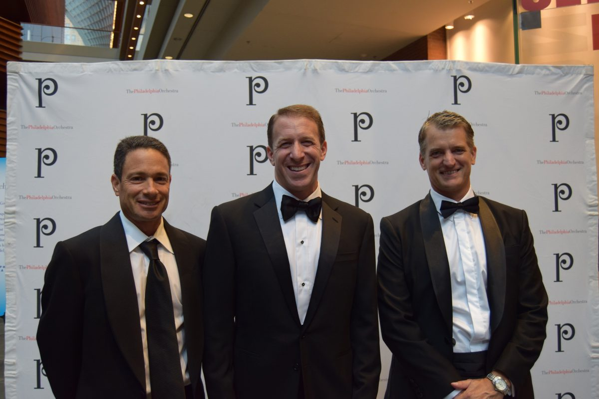 Gary Alan Frank, center, was charged Friday in a $30 million loan fraud. He is shown here at Opening Night of the Philadelphia Orchestra in Sept. 2016 at the Kimmel Center