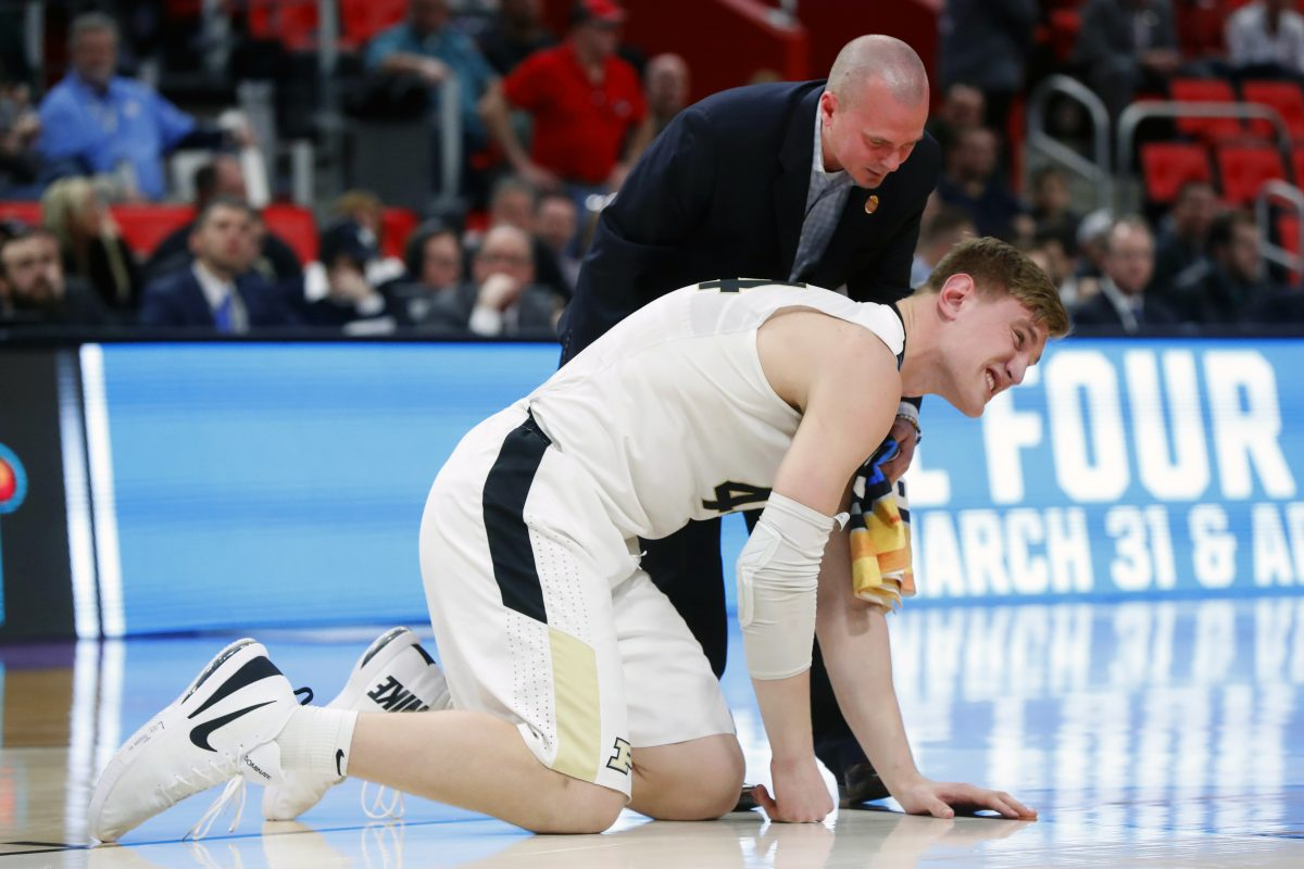 Purdue center Isaac Haas reacts to injuring his elbow during the Boilermakers' first-round win on Friday.