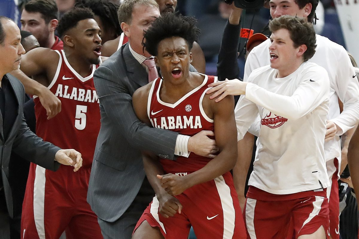 Alabama's Collin Sexton reacts to making game-winning shot against Texas A&M in the Southeastern Conference tournament.