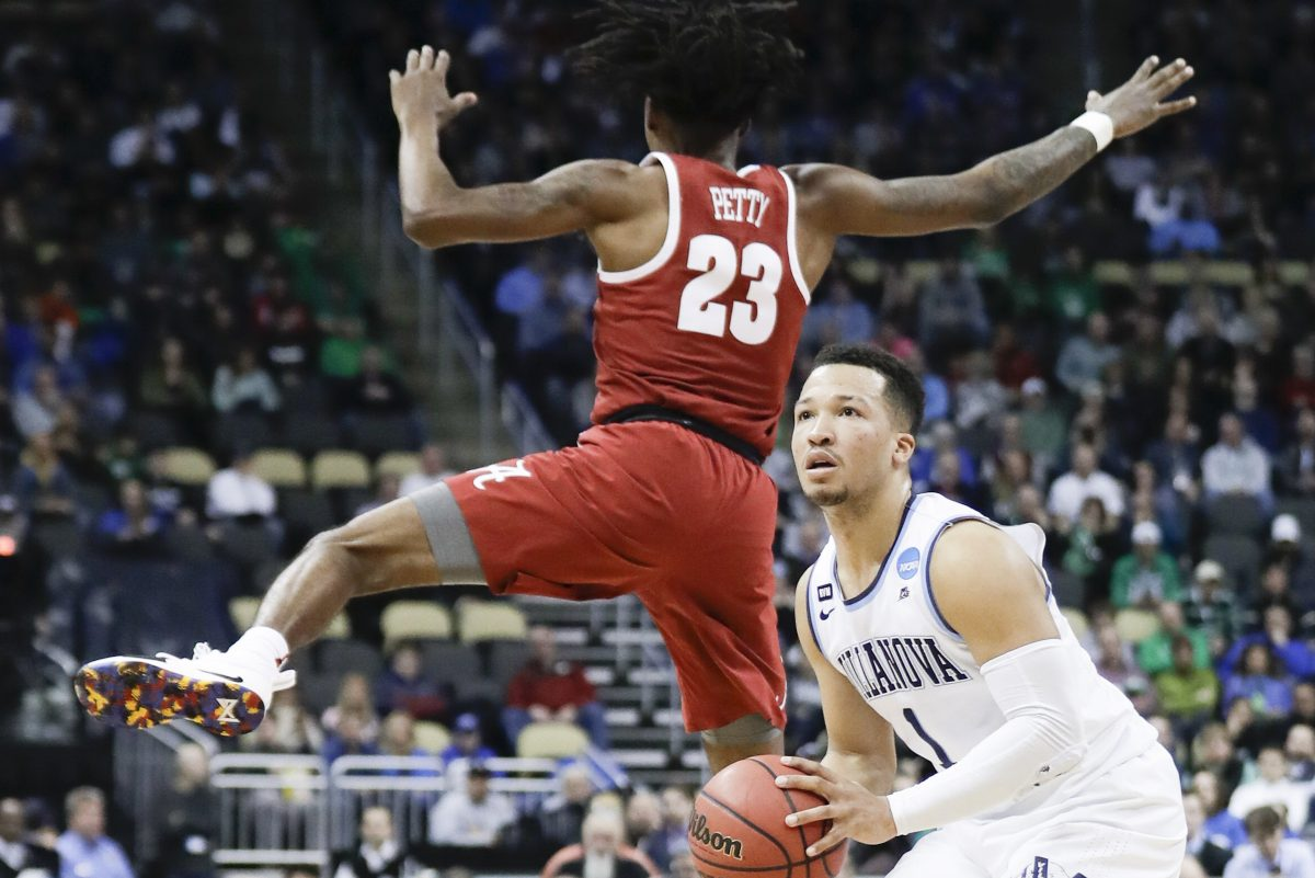 Villanova guard Jalen Brunson fakes his shot attempt past Alabama guard John Petty during the first-half in the second-round of the NCAA men´s basketball tournament on Saturday, March 17, 2018 at PPG Paints Arena in Pittsburgh. YONG KIM / Staff Photographer